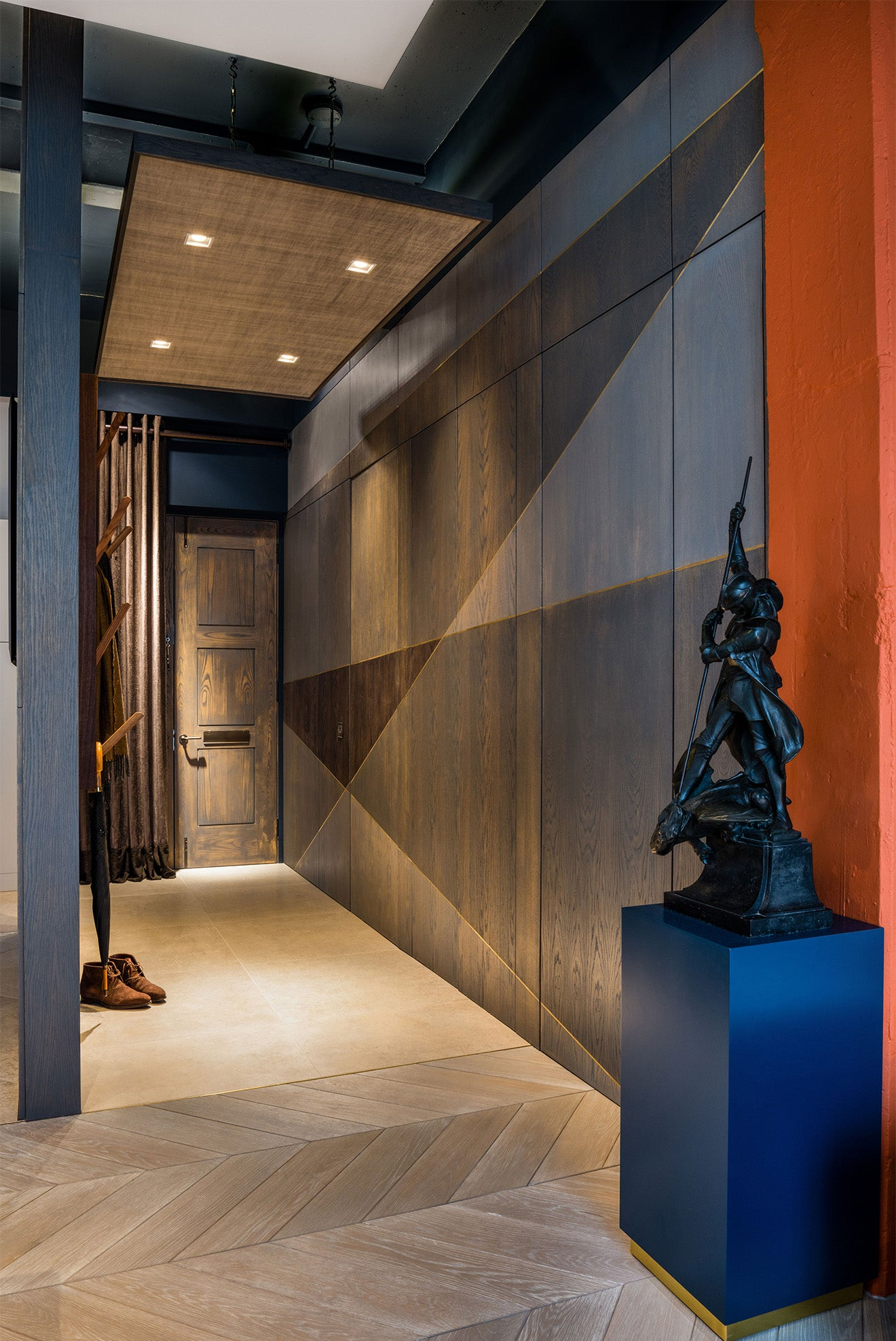 Luxury interior design hallway by Daniel Hopwood with orange and blue detailing