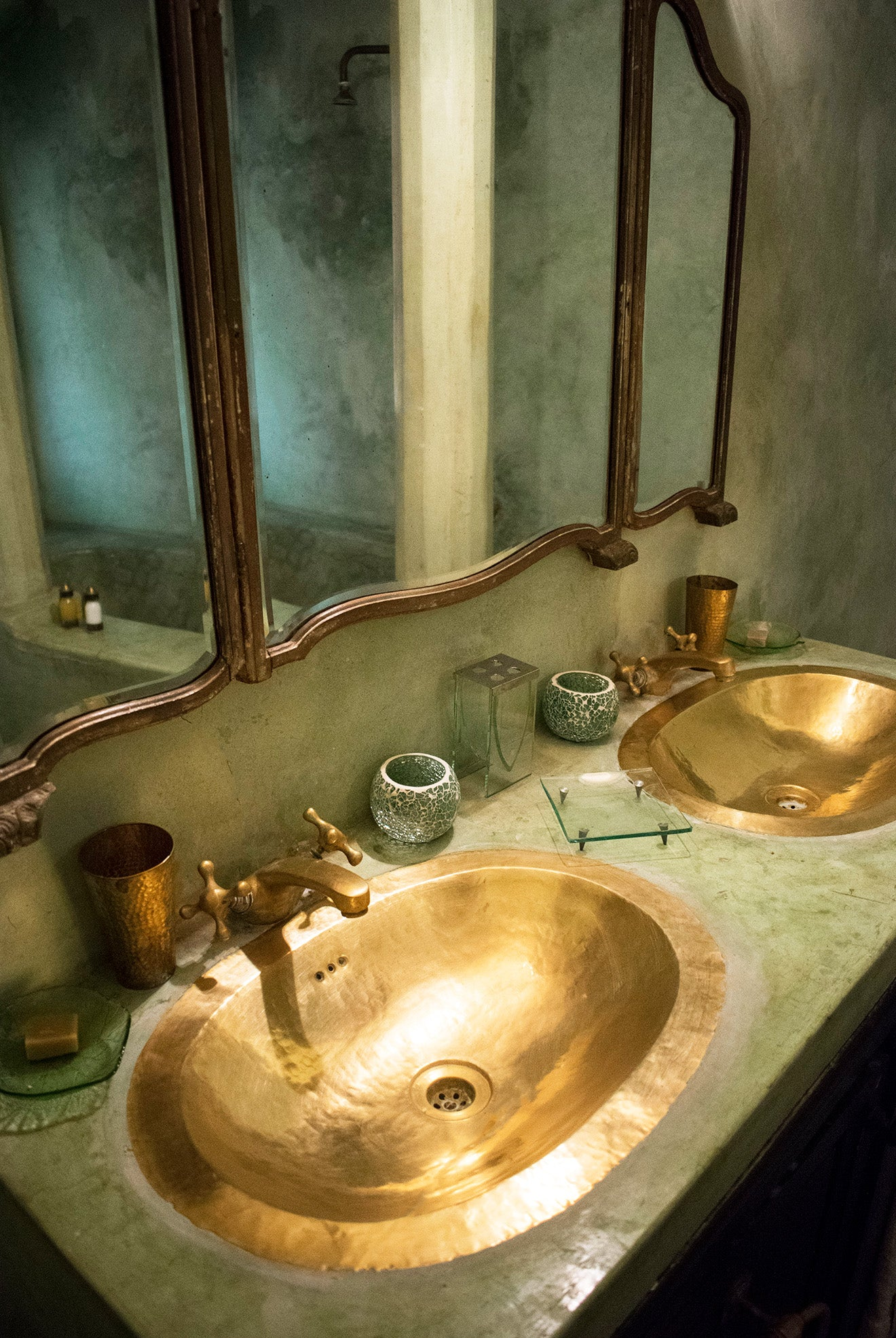 Mint moroccan bathroom with brass gold wash basins