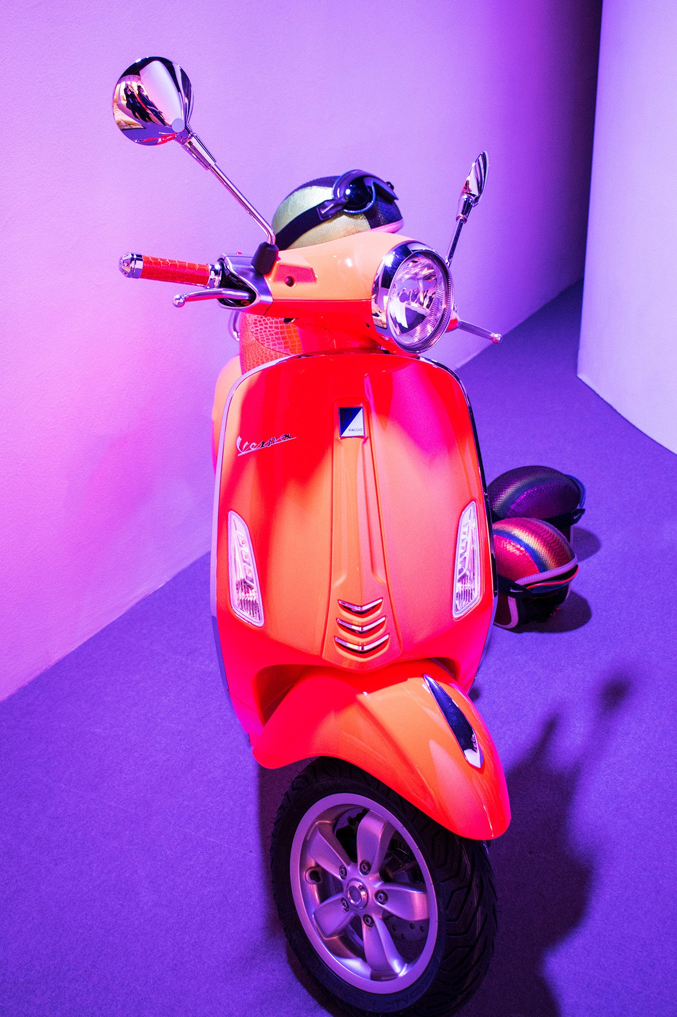 Luminous orange scooter on display at Salone del Mobile