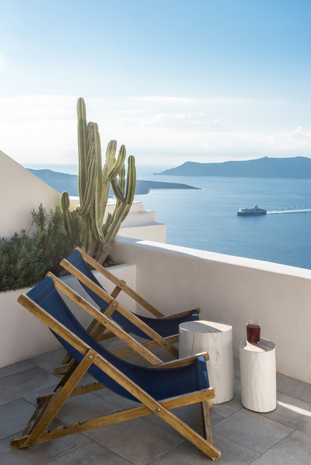 relaxing in a deckchair on a Santorini rooftop - Laboratorium designs the beautiful Porto Fira Suites in Santorini
