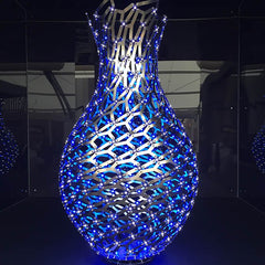 Metal artwork with blue lights featured at Decorex
