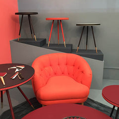 Red chair on display at Decorex