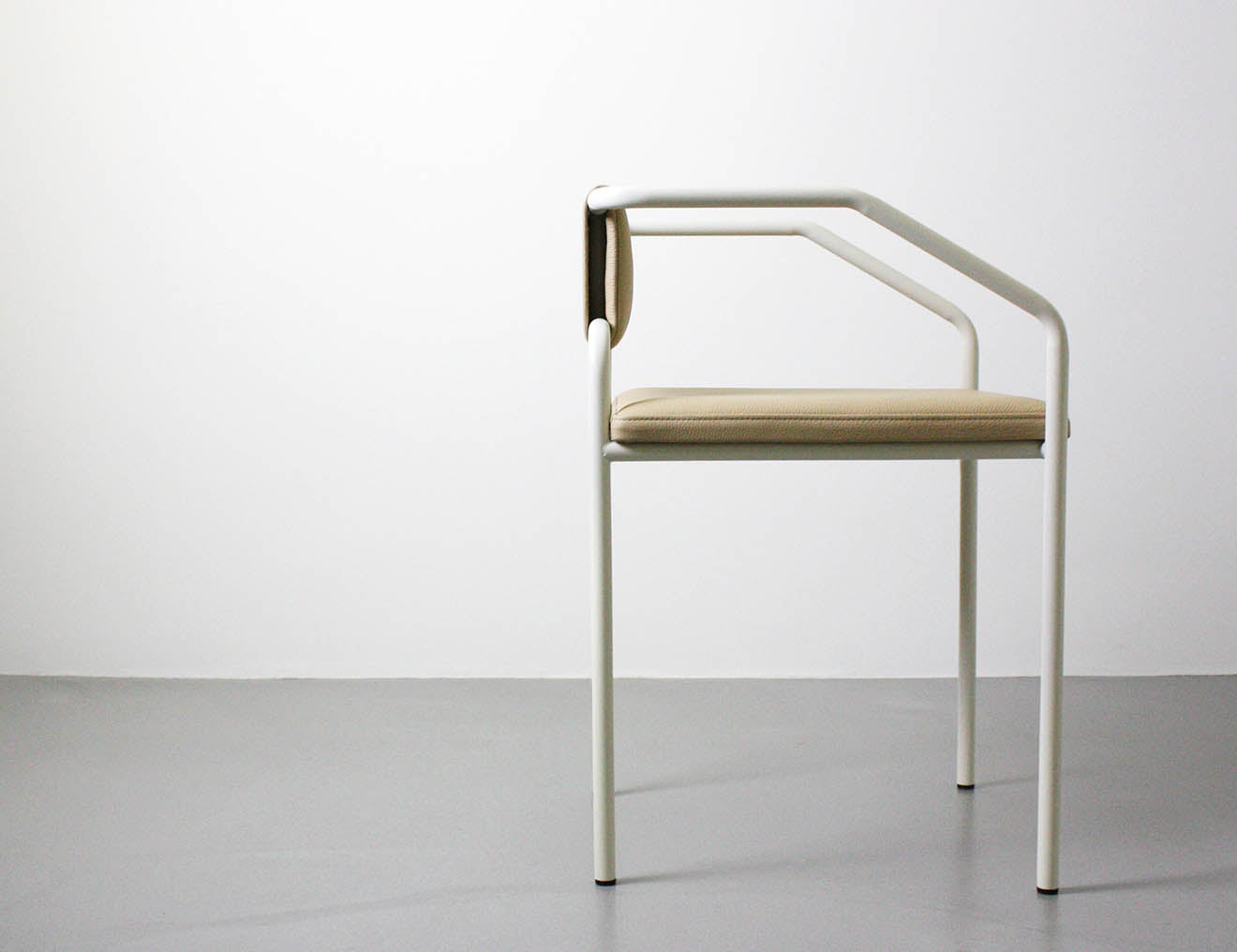 Upholstered metal arm chair, oblique from Dubokk designs