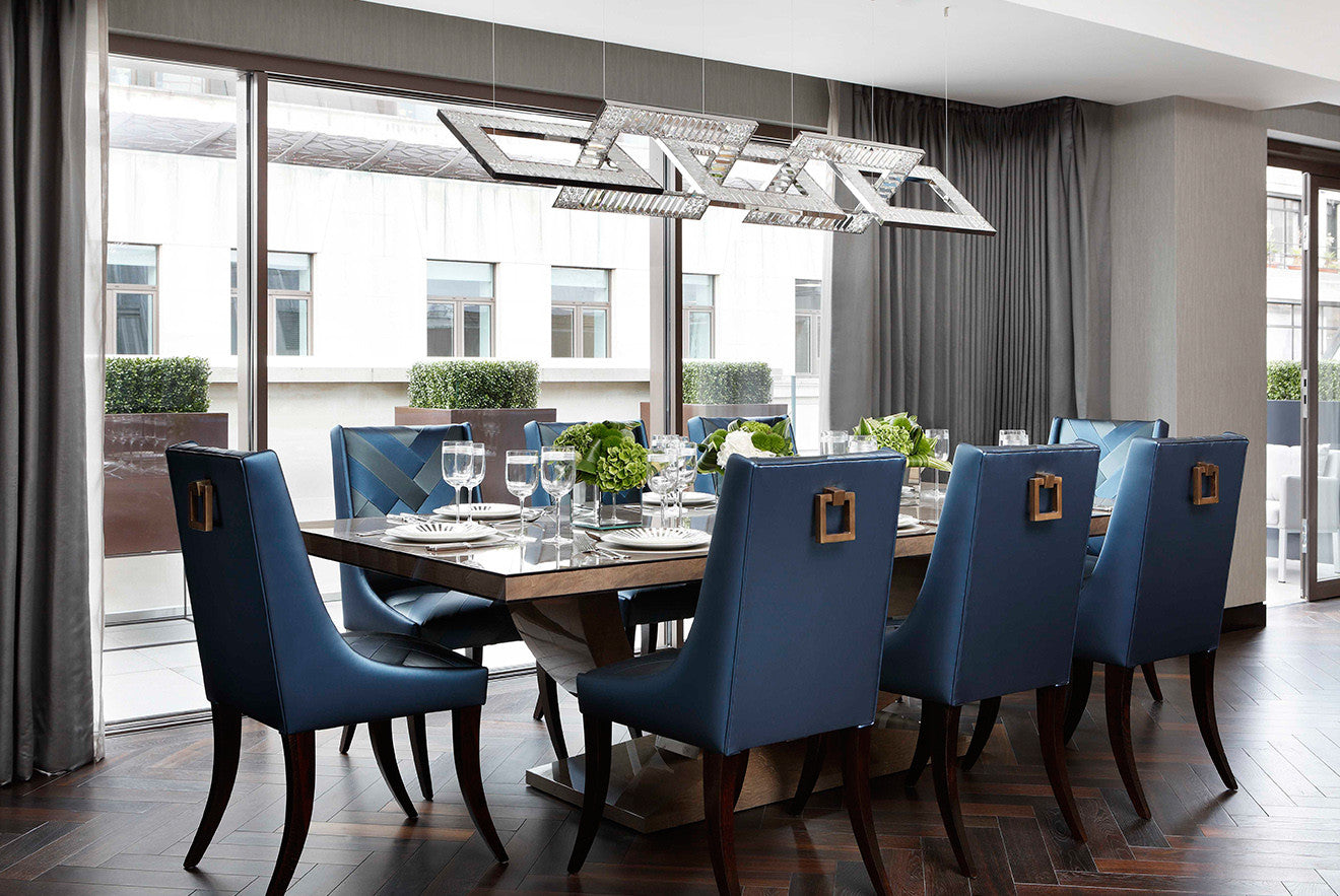 Dining room with blue chairs Beau House penthouse apartment designed by Oliver Burns