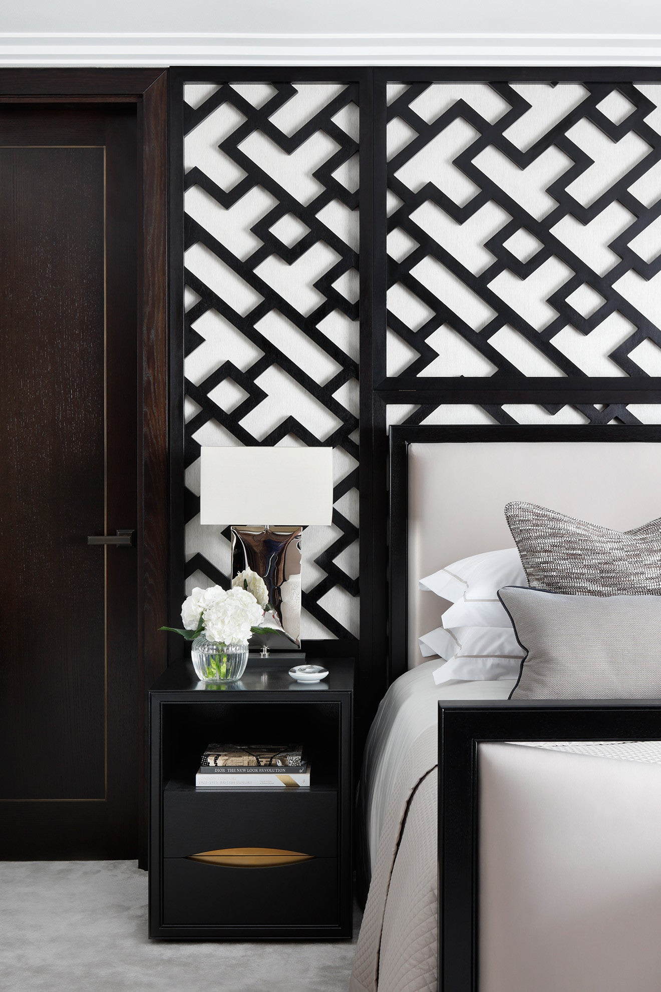 Master bedroom suite with decorative trellis style wall finish design by Oliver Burns Beau House Penthouse