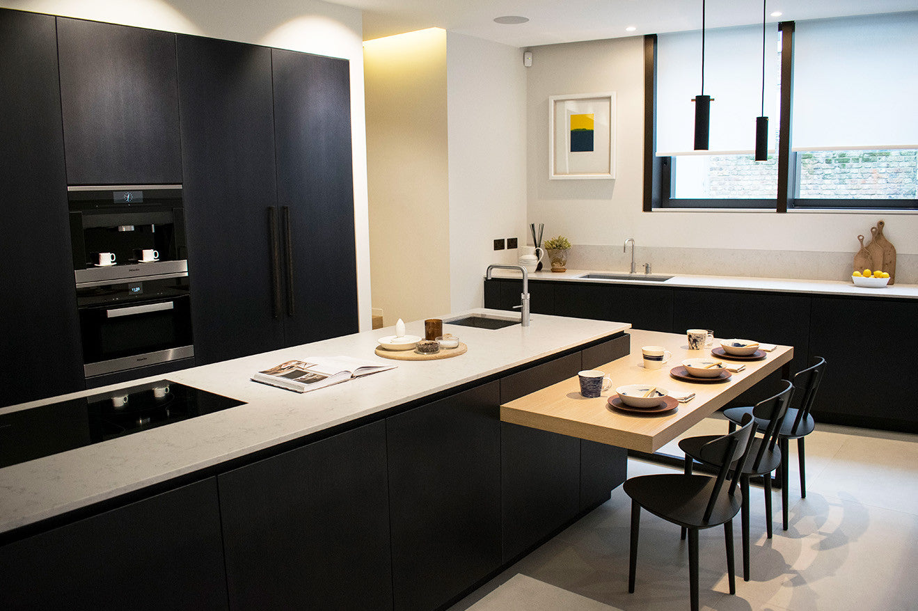 Black and white kitchen design with lower wooden breakfast area Kenure House Holland Park