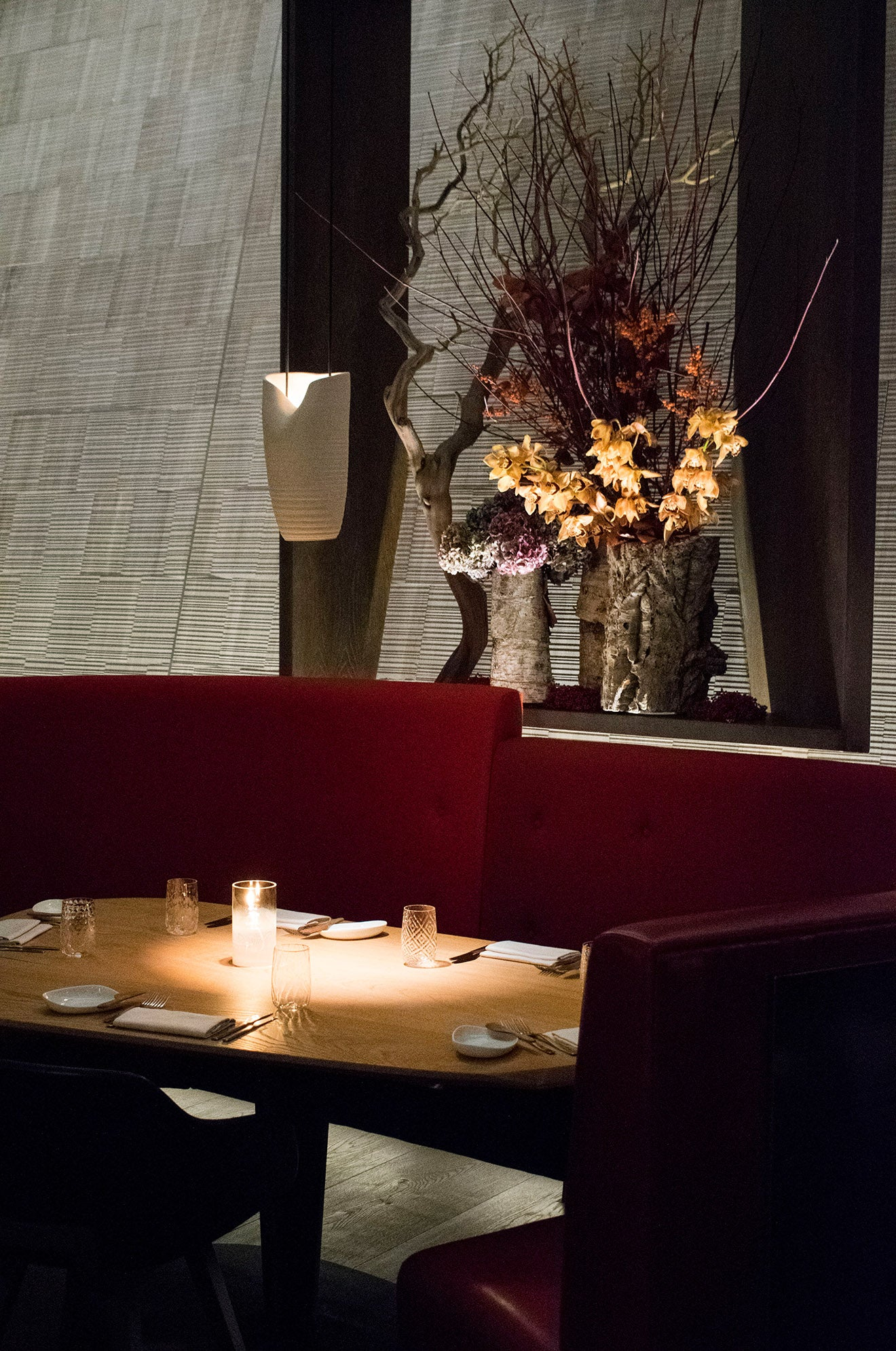 Eneko Restaurant London One Aldwych with red booth seating