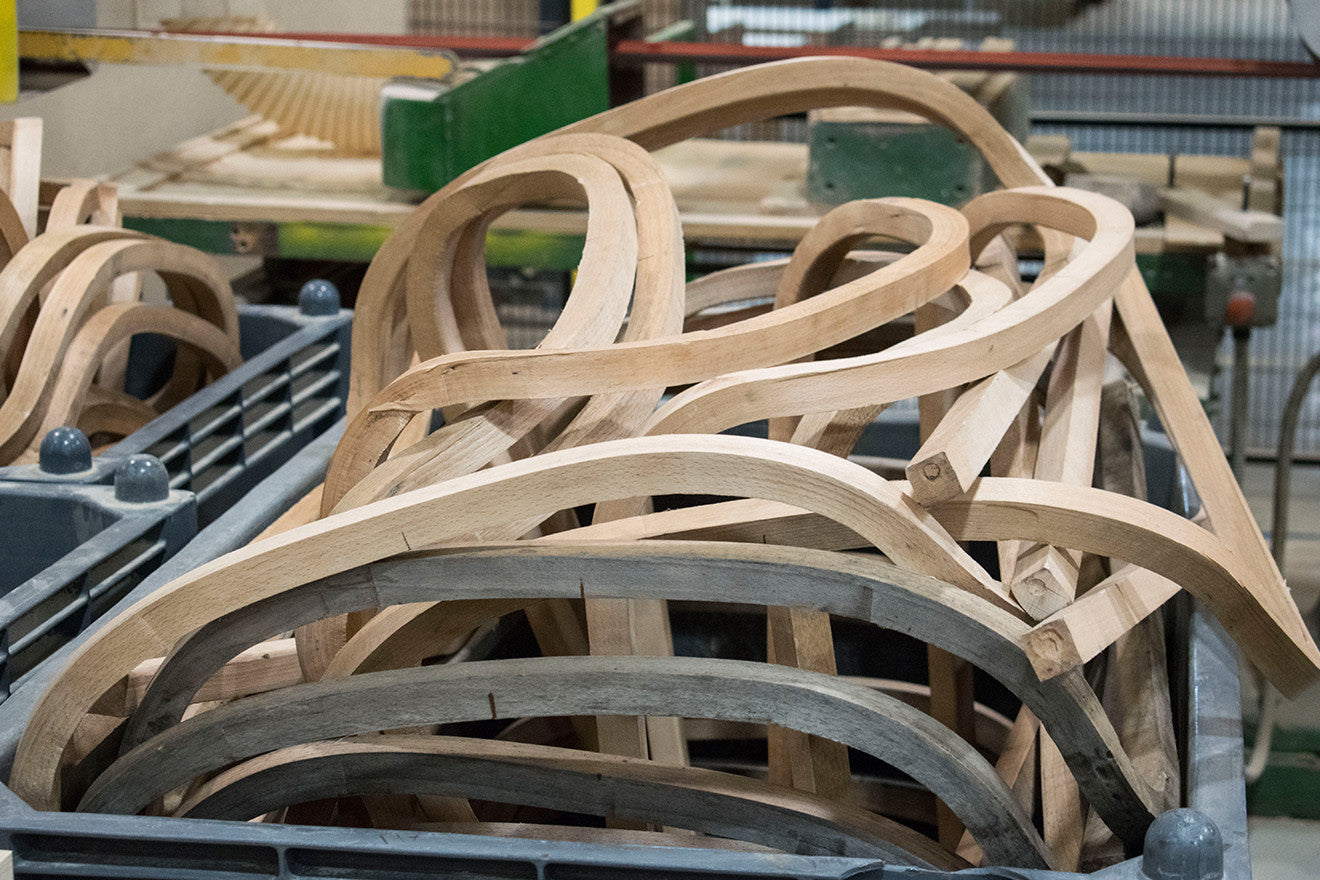 Curved pieces of wood ready to be sanded into chair arms