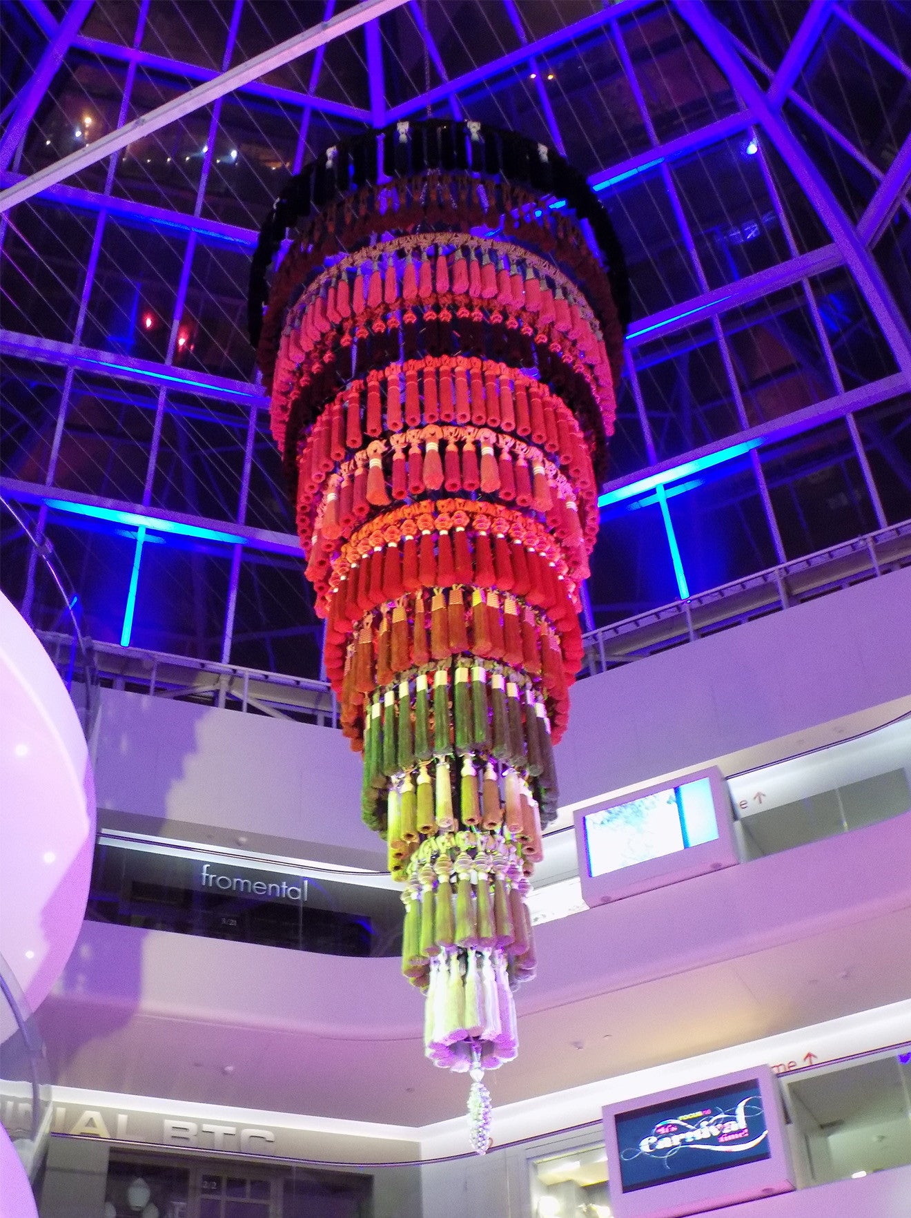 Large chandelier made up of coloured tassels