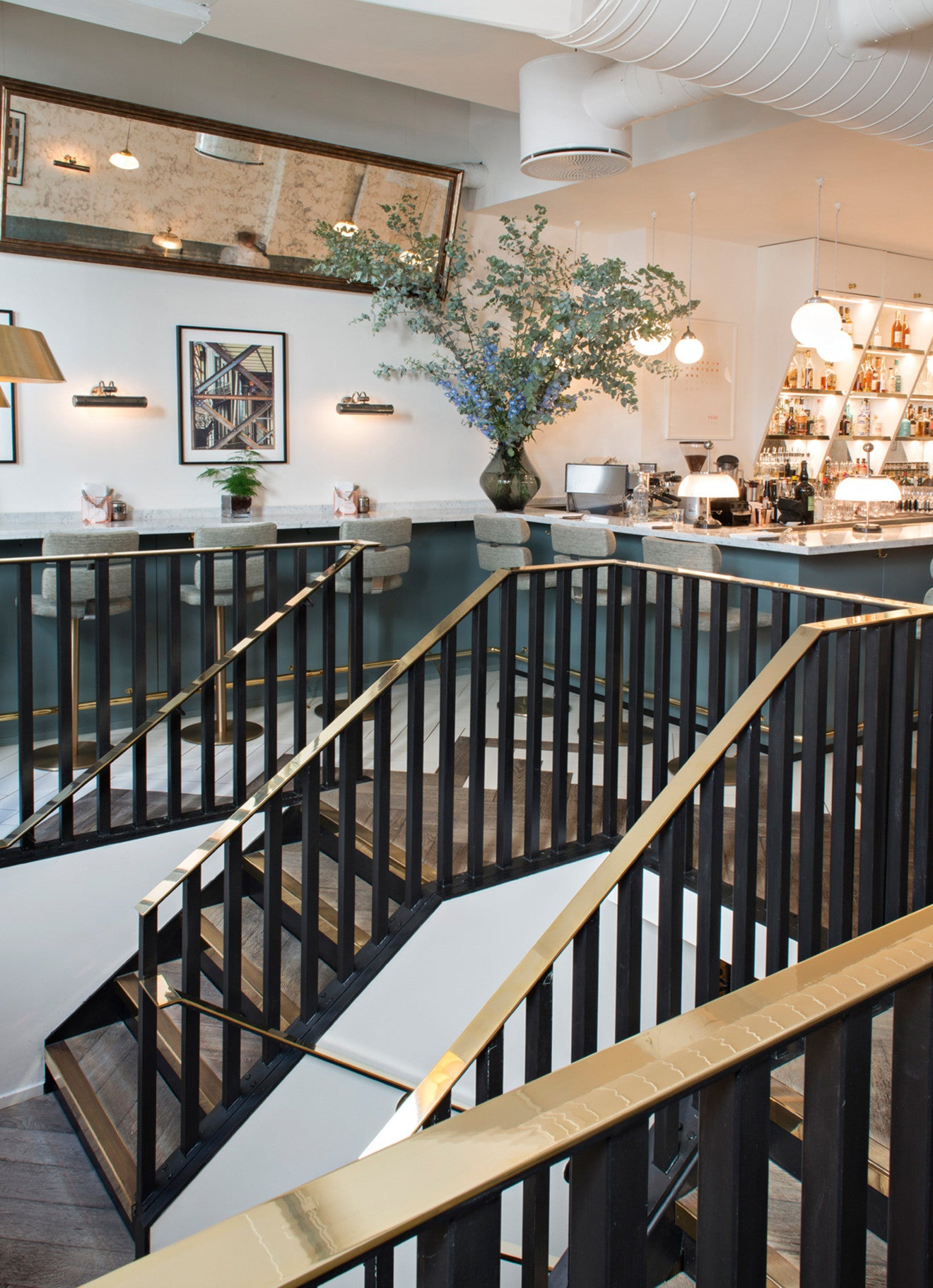 Brass and wood staircase at Frenchie restaurant in Covent Garden London