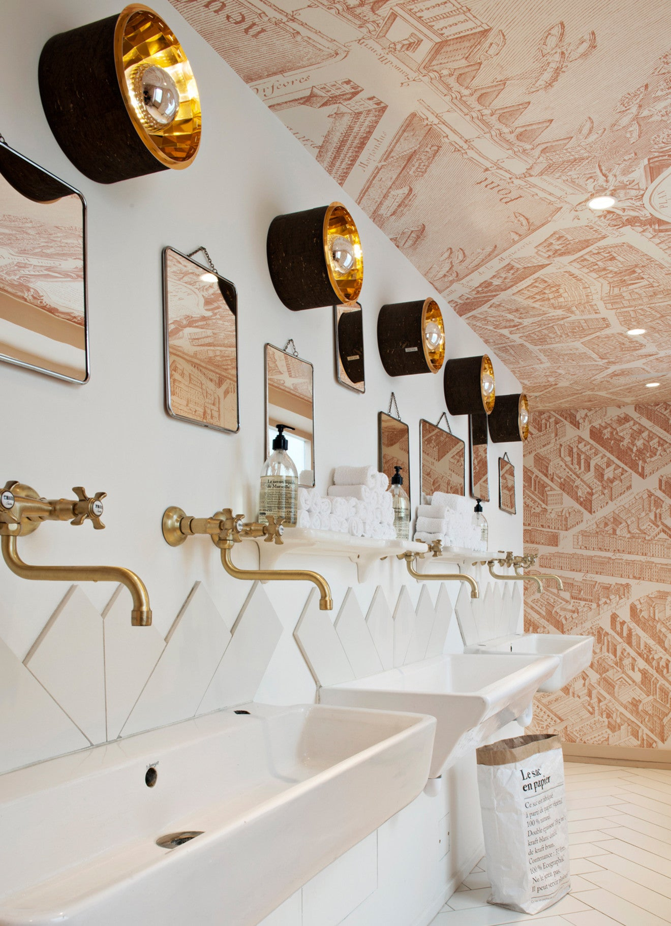 Frenchie contemporary washrooms with dual sinks and brass taps