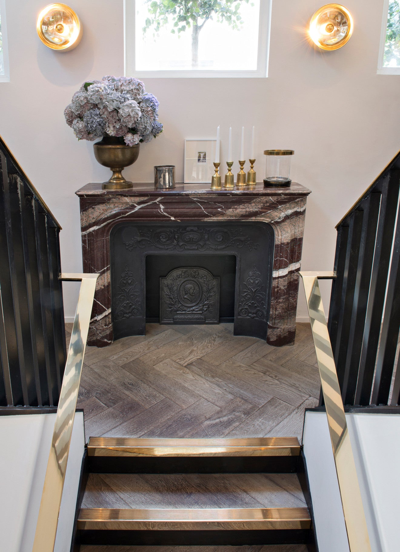 Stairs leading to a dark marble vintage fireplace Frenchie Covent Garden
