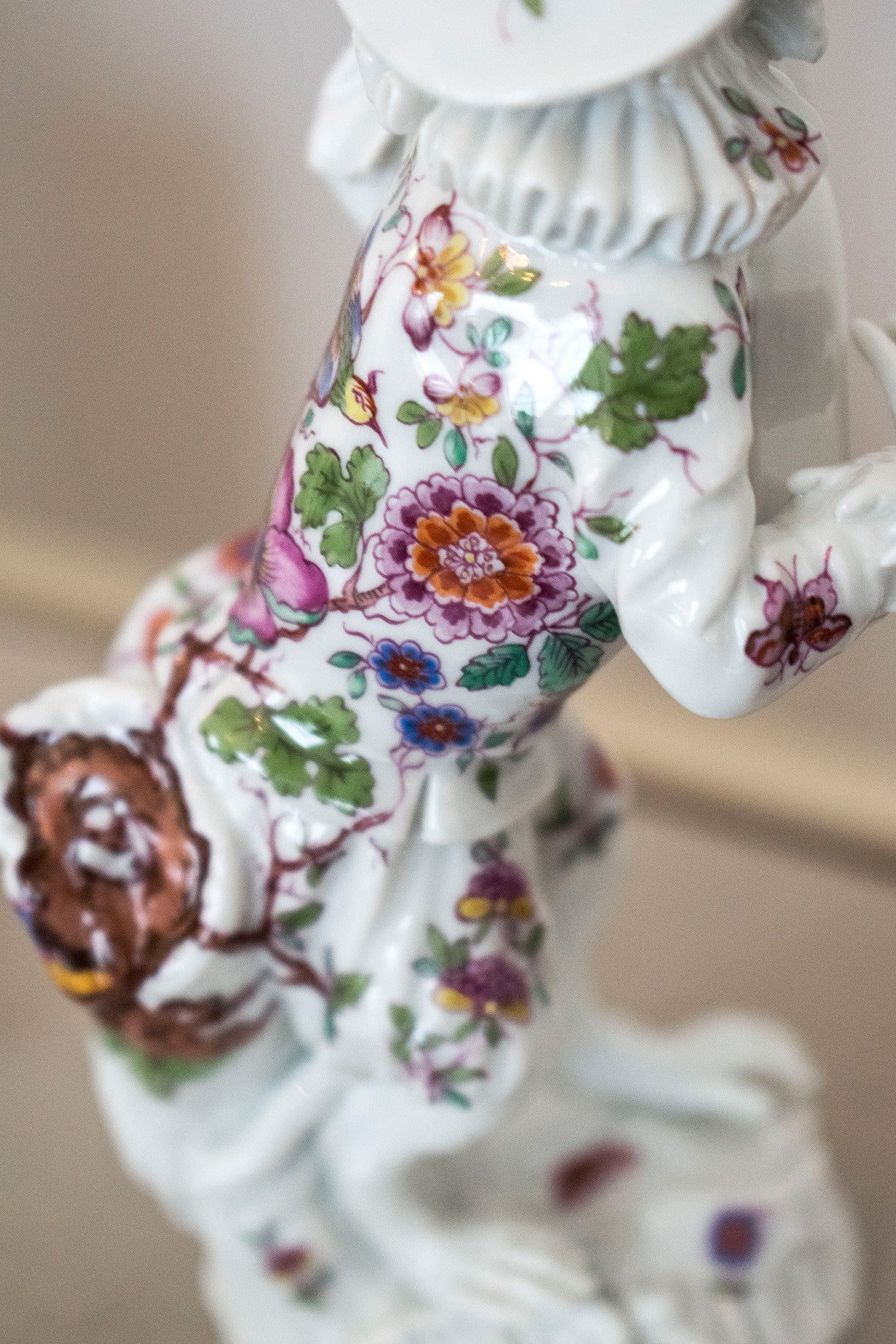 Floral hand painted Meissen monkey figurine