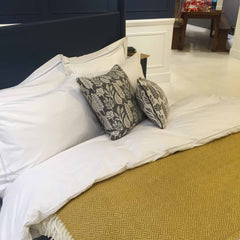 Heals Pinner collection bed with white duvet and mustard throw