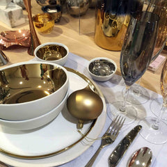 White and gold table setting from Heals