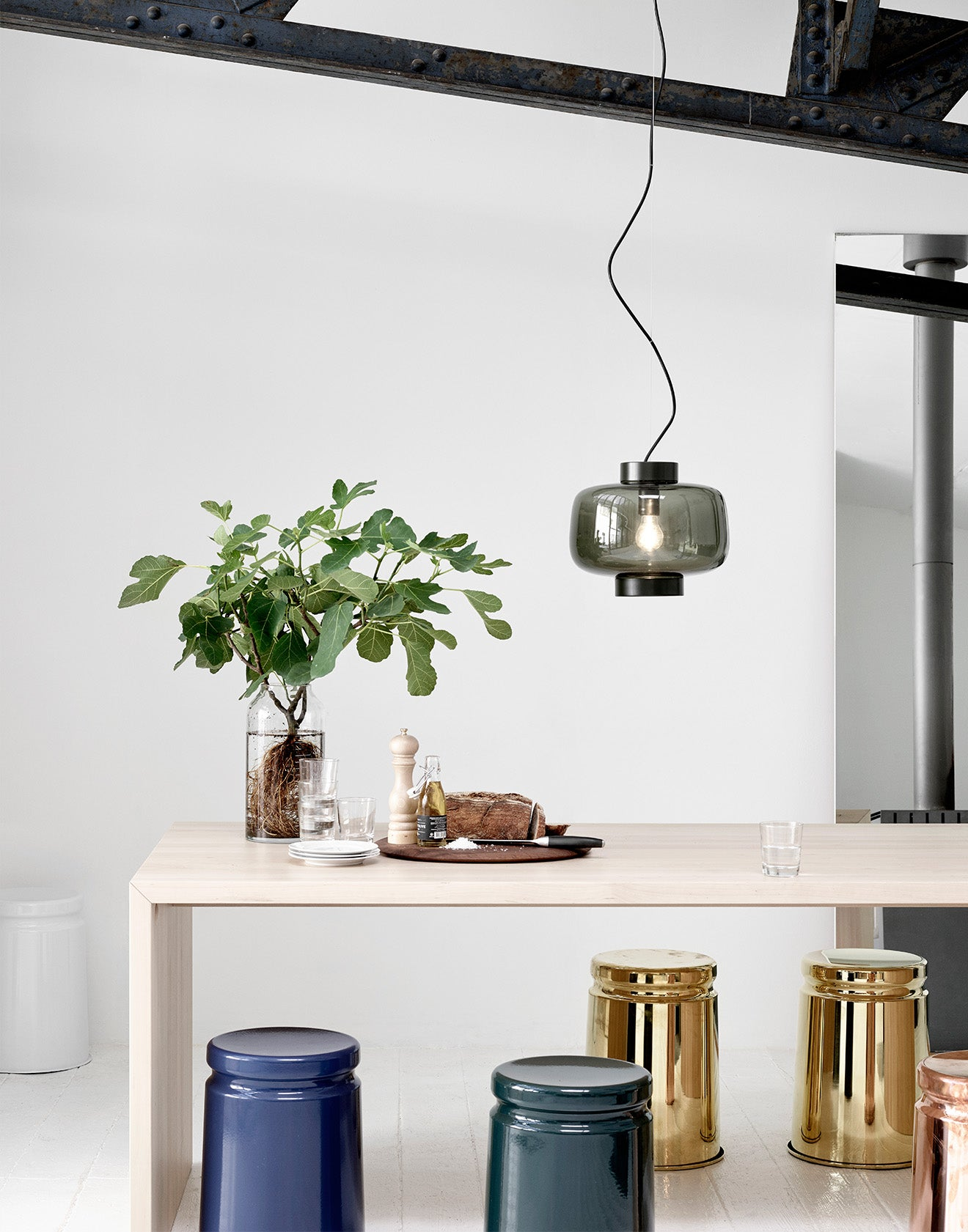 Hem furniture designs dusk pendant lighting and steel stools in Scandinavian dining space