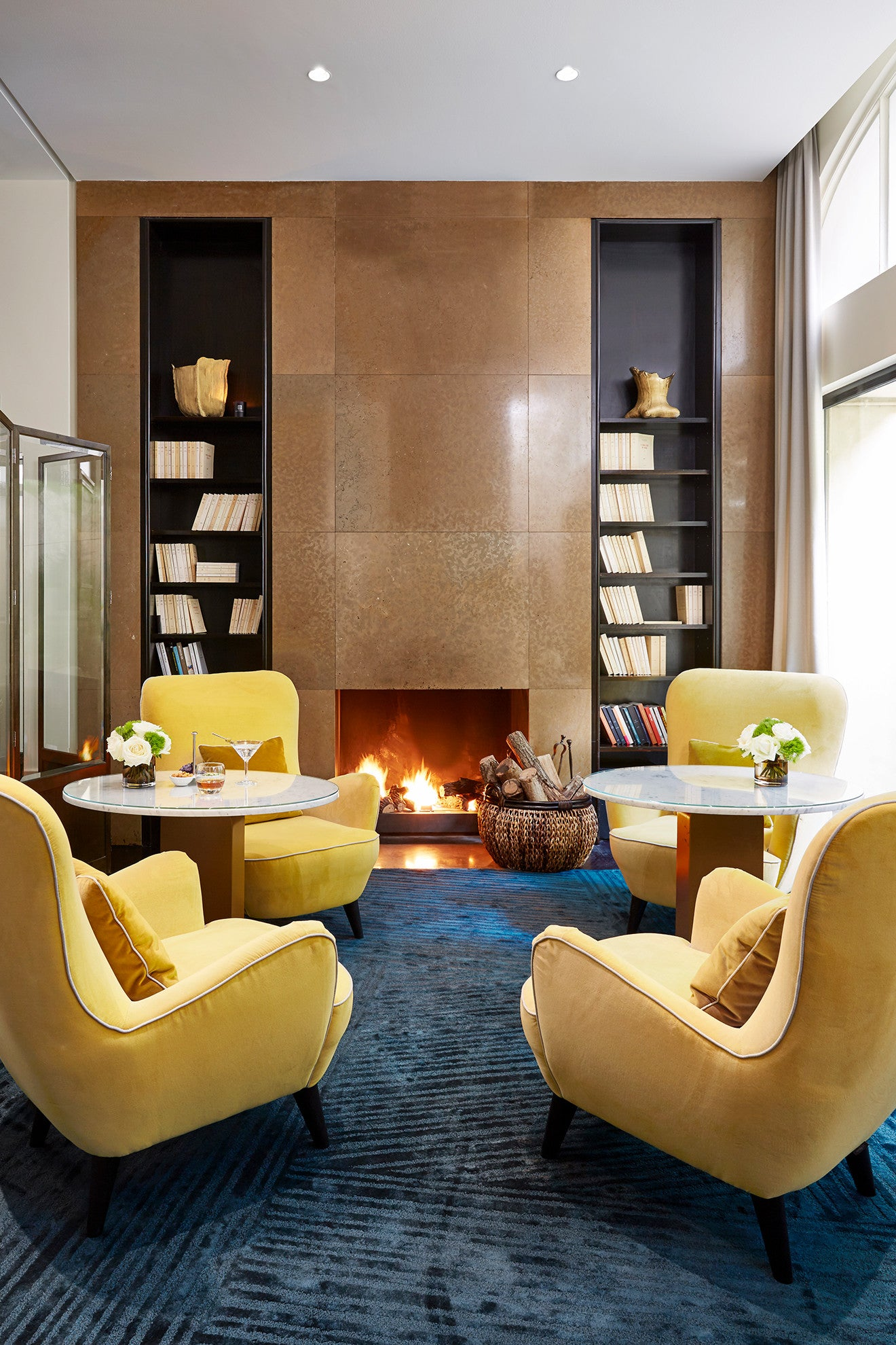 Contemporary lounge and bar in front of an open fire at Hotel Montalembert