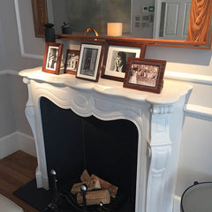 LINLEY fireplace with assorted photo frames