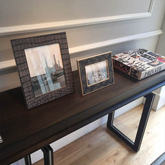 LINLEY Helis sidetable console with assorted photo frames