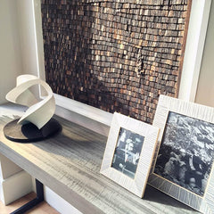 LINLEY fireplace with textured modern artwork