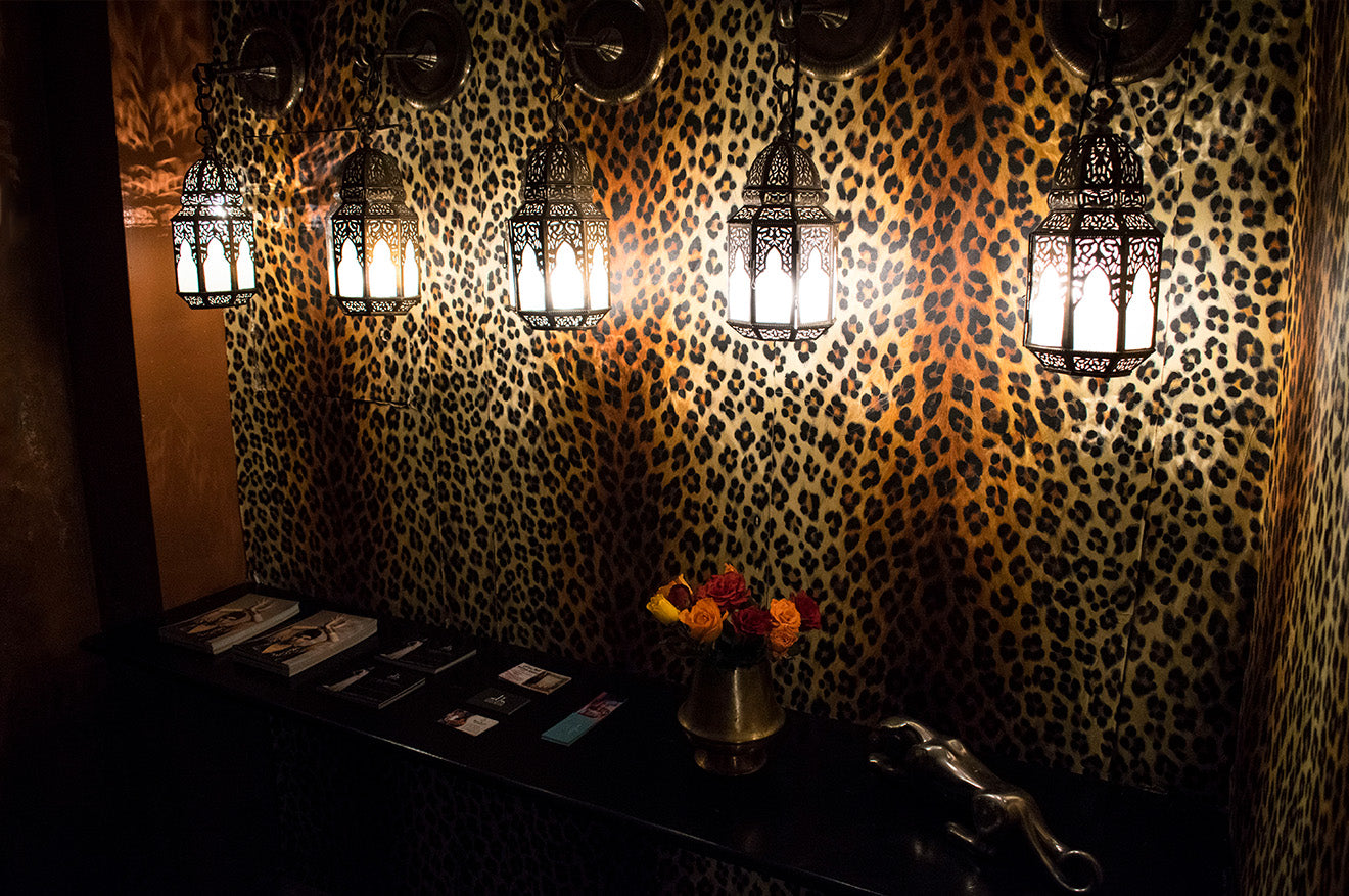 traditional Moroccan lanterns against leopard print wallpaper