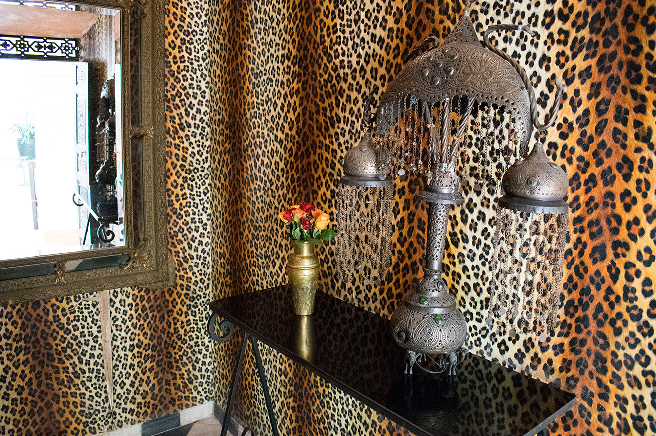 Syrian table lamp against leopard print wallpaper at Dar Jaguar