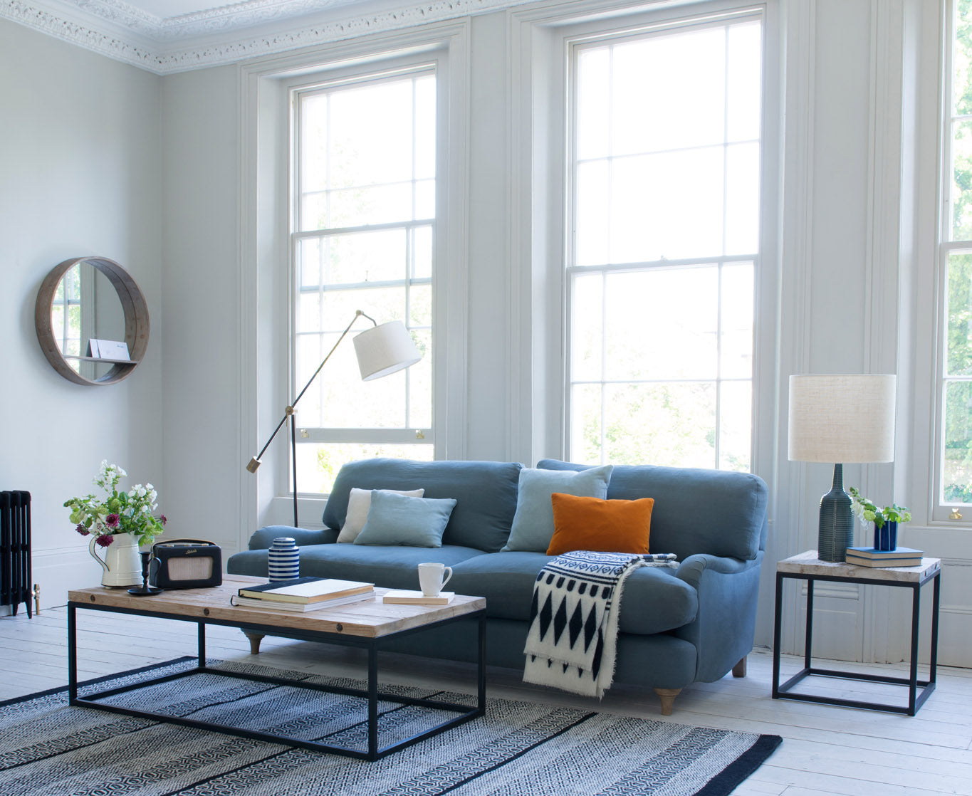 Loaf rustic interior design with blue sofa and vibrant cushion combinations
