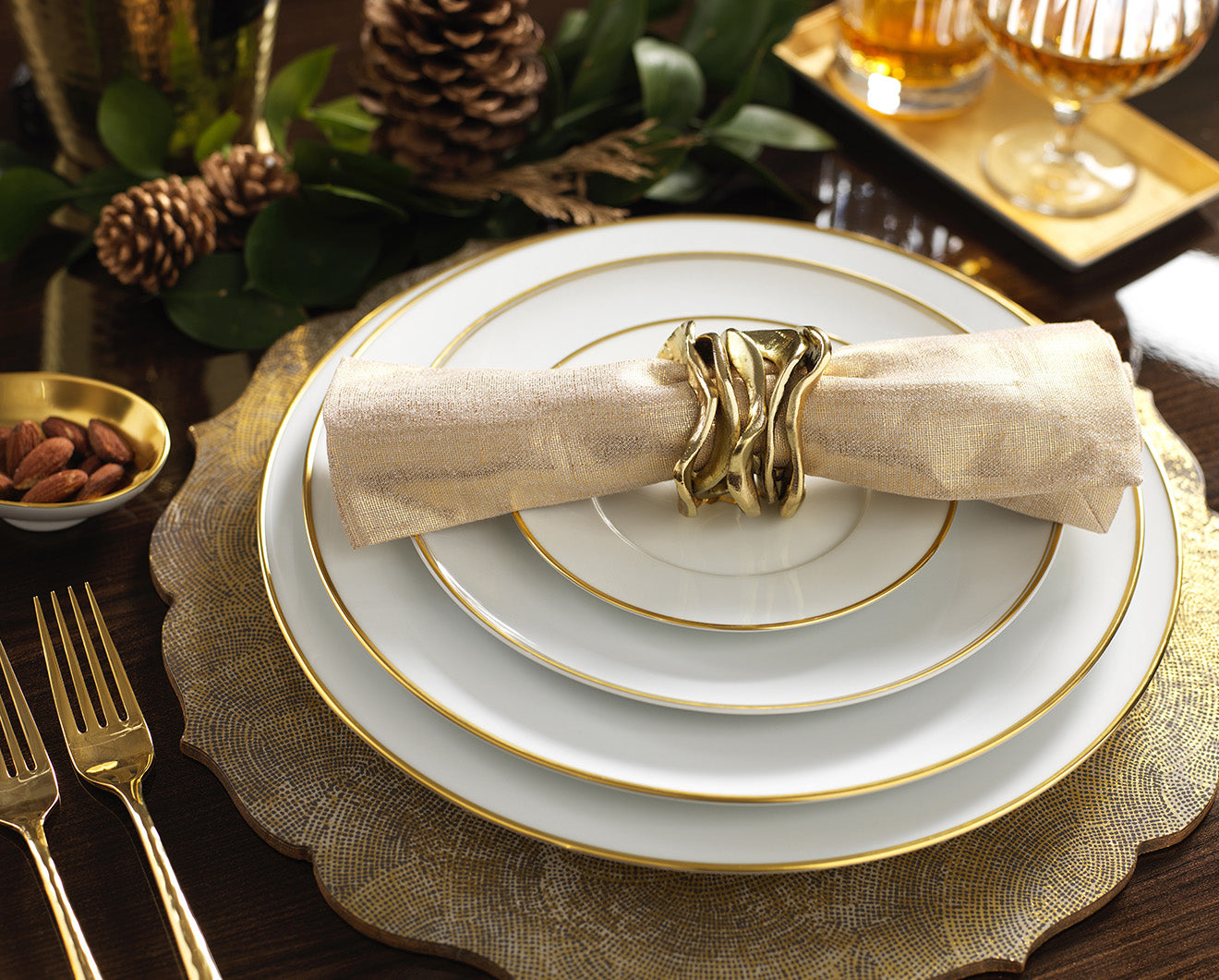 Luxury Christmas table setting with white and gold crockery