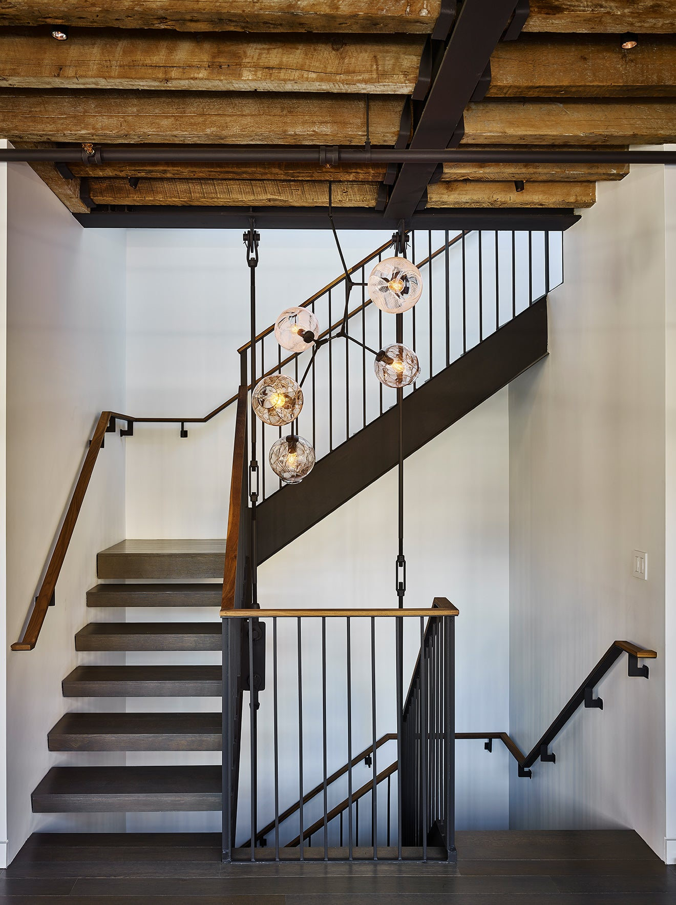 Industrial stairs with exposed wooden beams warehouse apartment New York