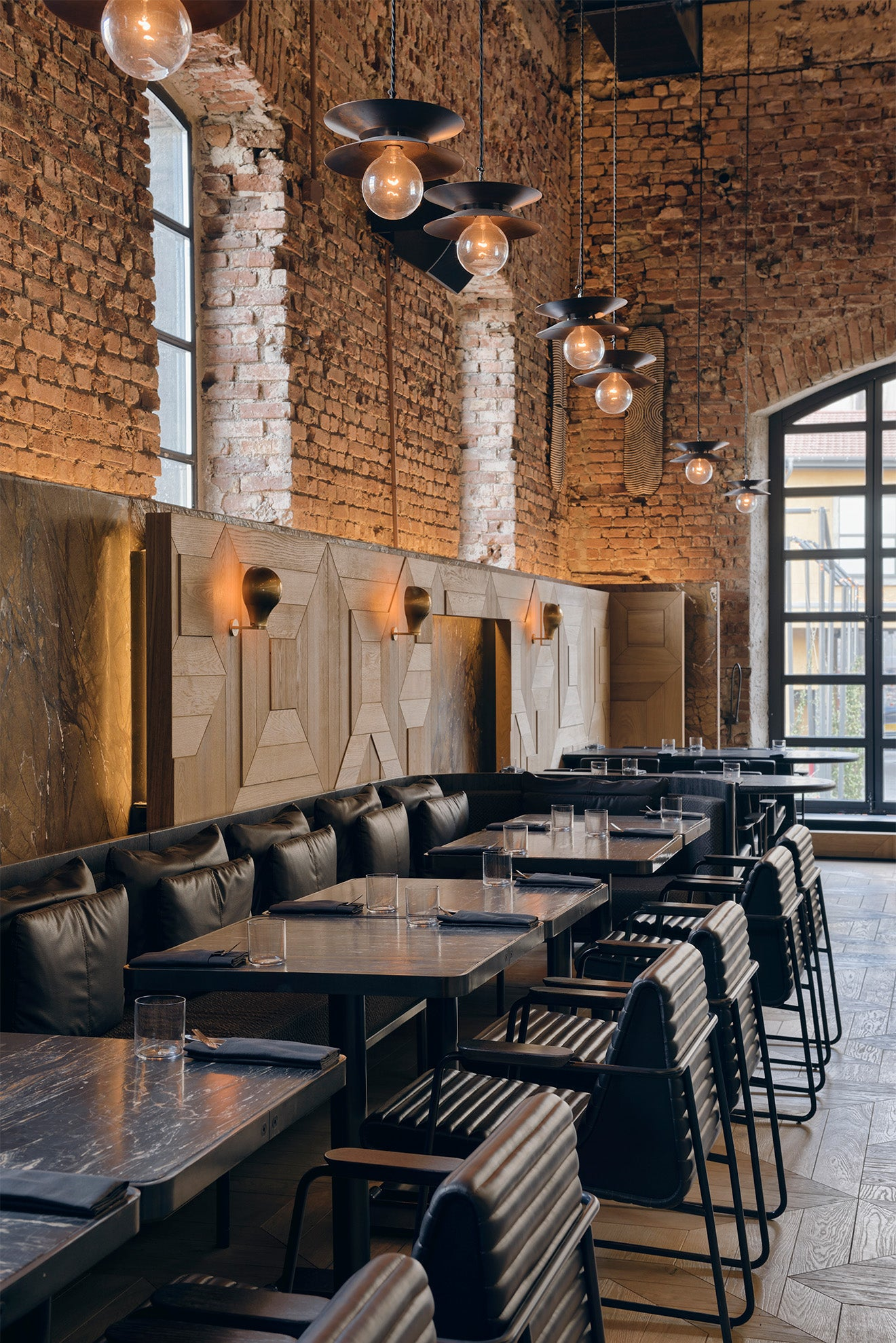 Luxury restaurant interior design exposed brickwork and industrial lighting
