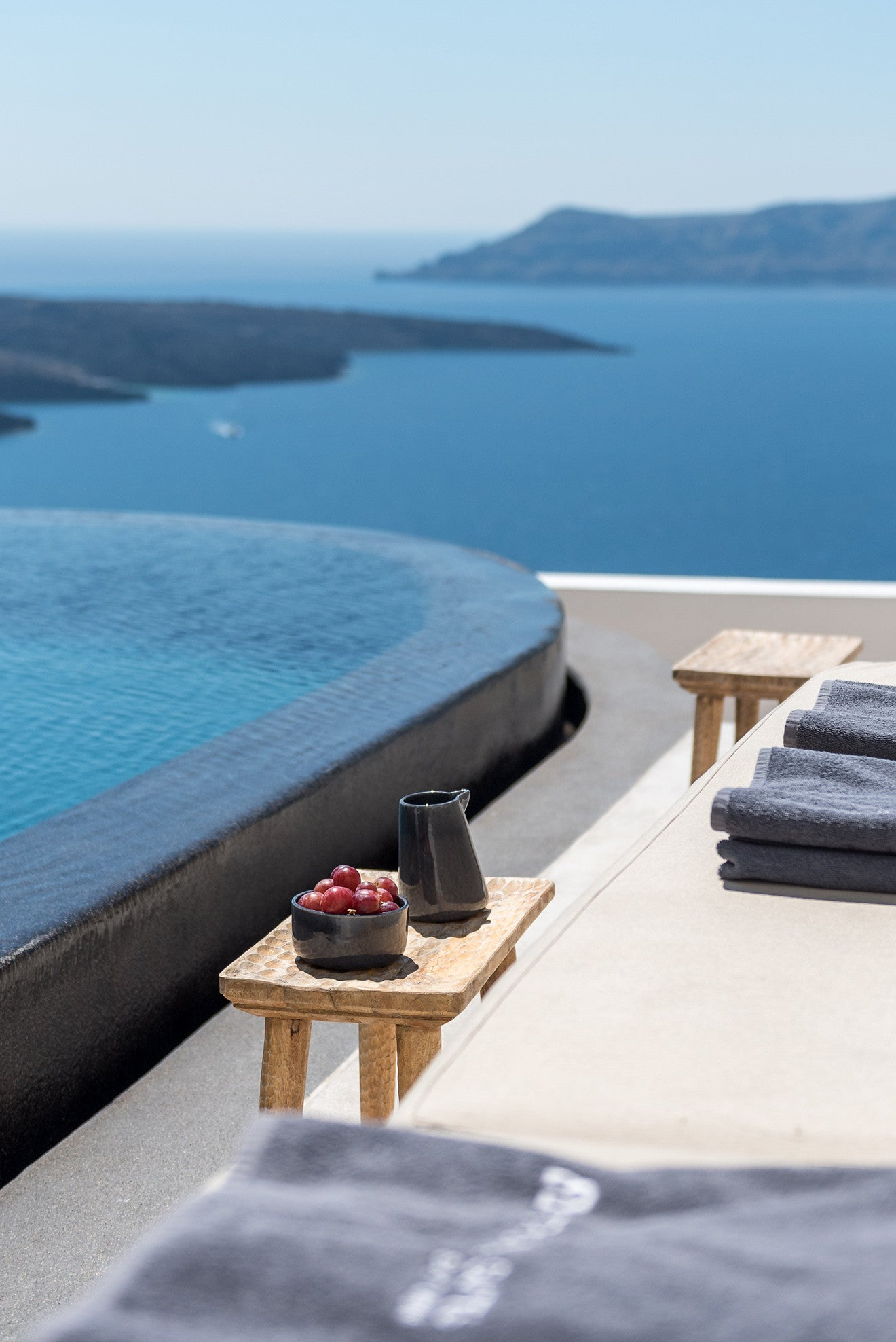 Black infinity pool looking out across the sea at Santorini - Laboratorium designs the beautiful Porto Fira Suites in Santorini