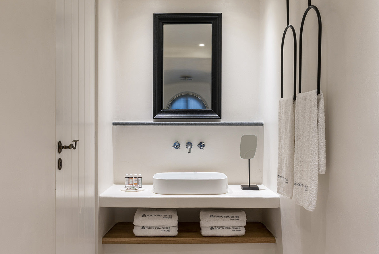 Luxury washroom and suite with black mirror and abstract towel rails