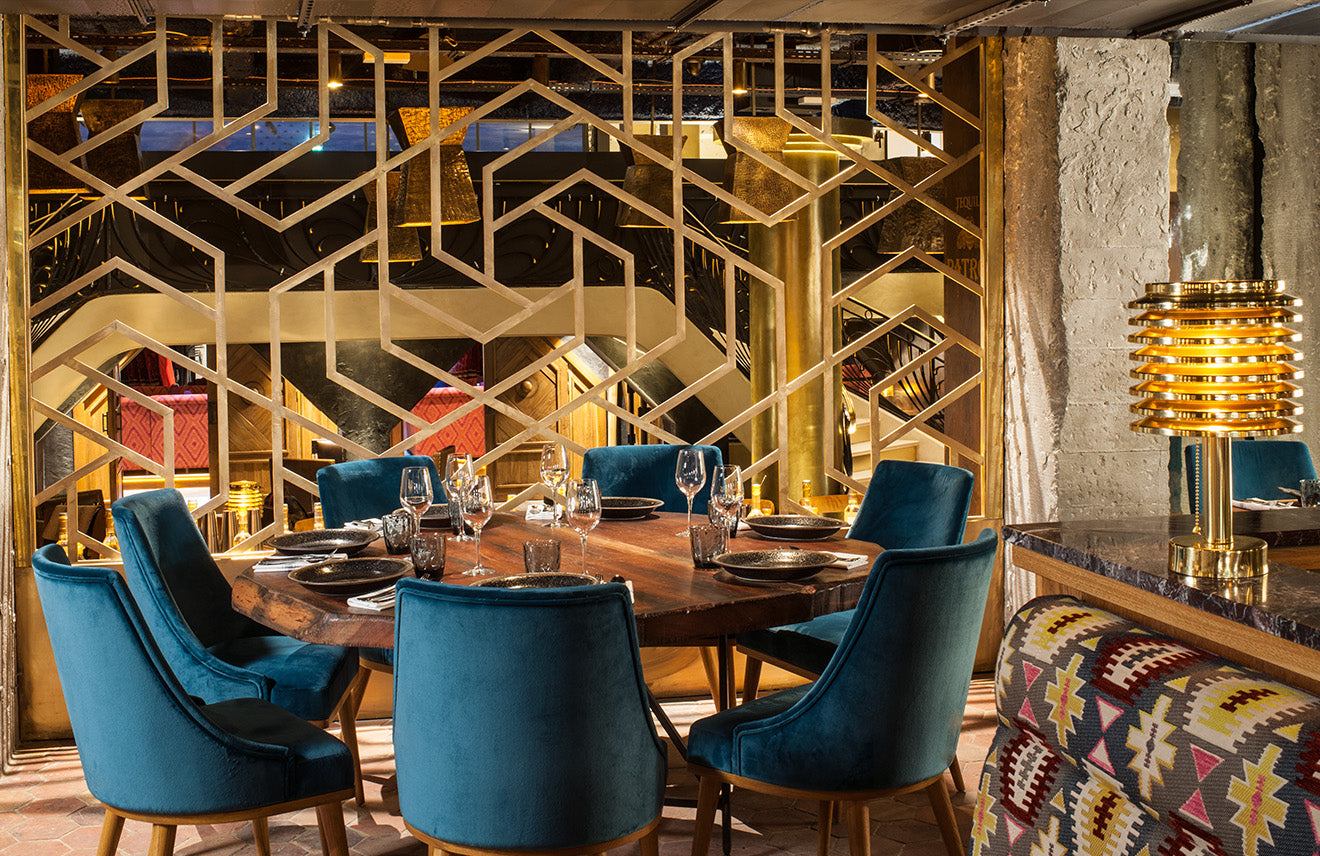 luxurious Parisian restaurant in gold and blue designed by Laura Gonzalez