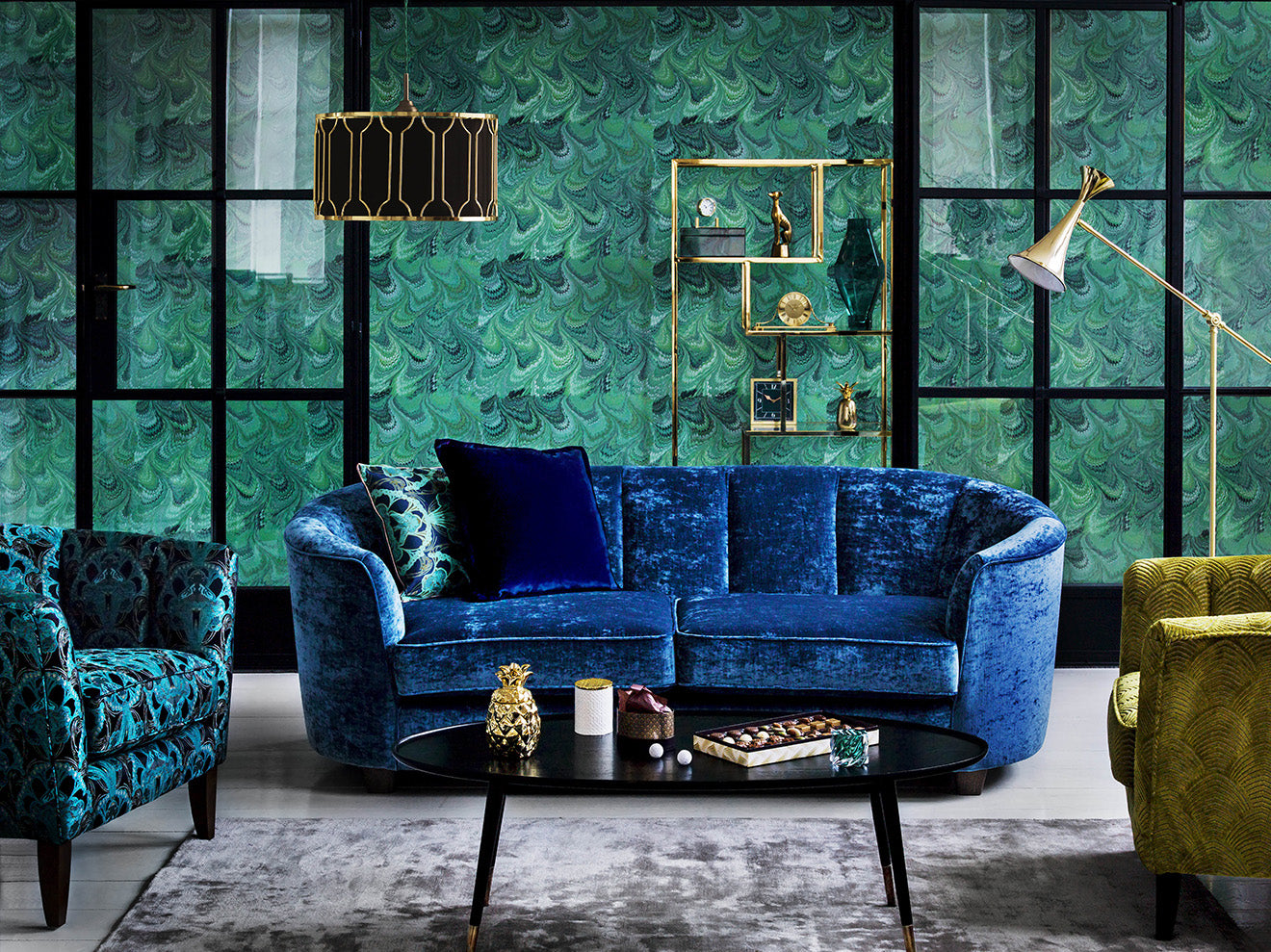 Marks and Spencer Home new season collection blue sofa and green wallpaper