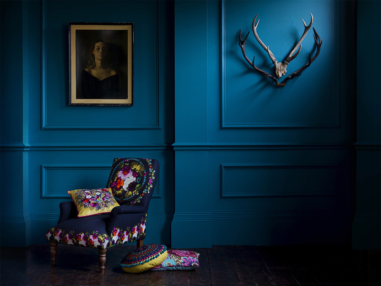 Marks and Spencer new season collection embroidered cushions in dark blue room