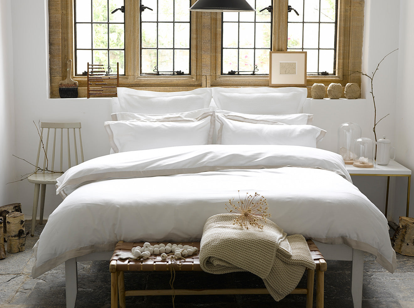 Luxury bedding collections from Christy Cream and white