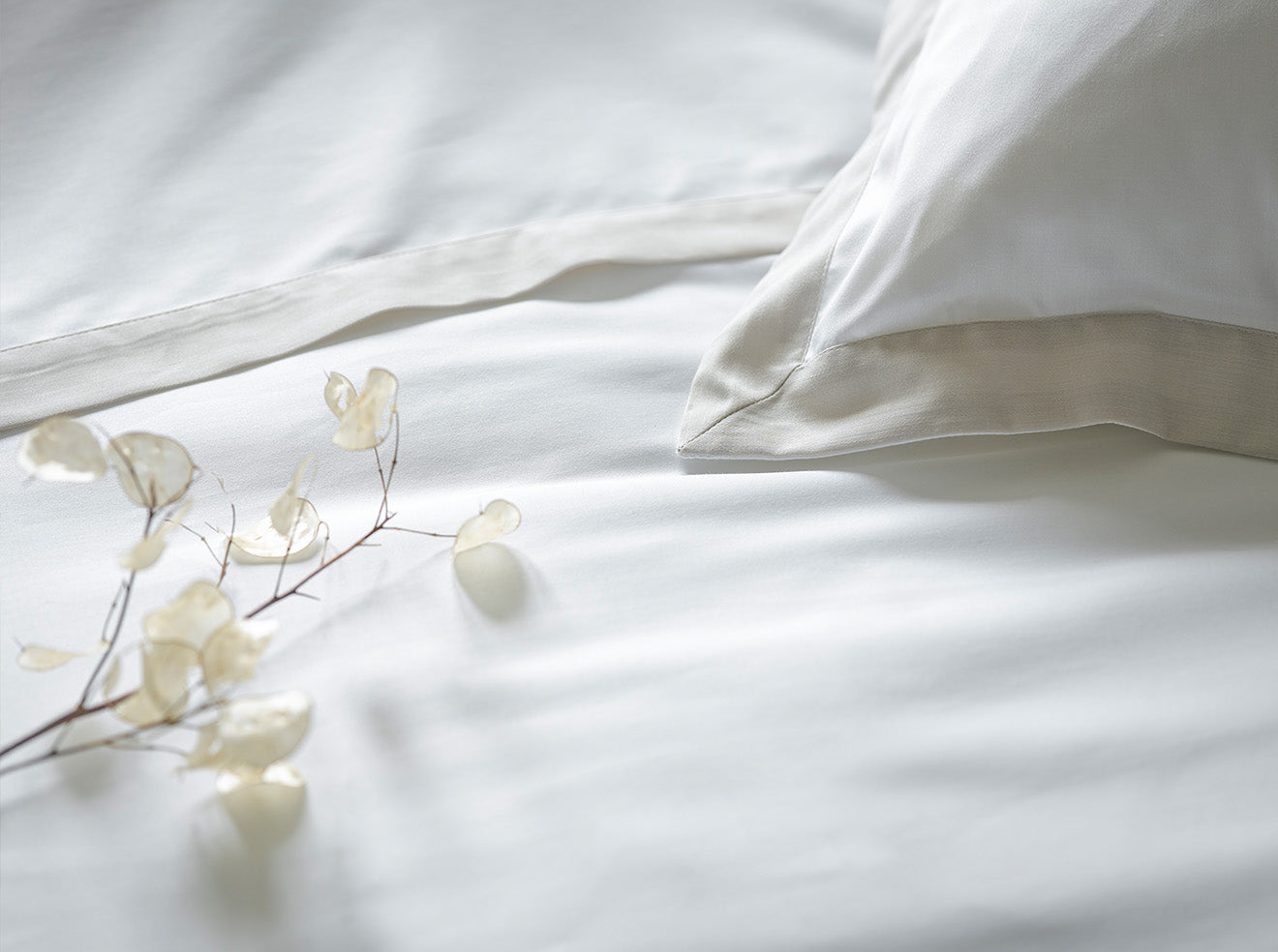 Clean simple white luxury bedding from Christy