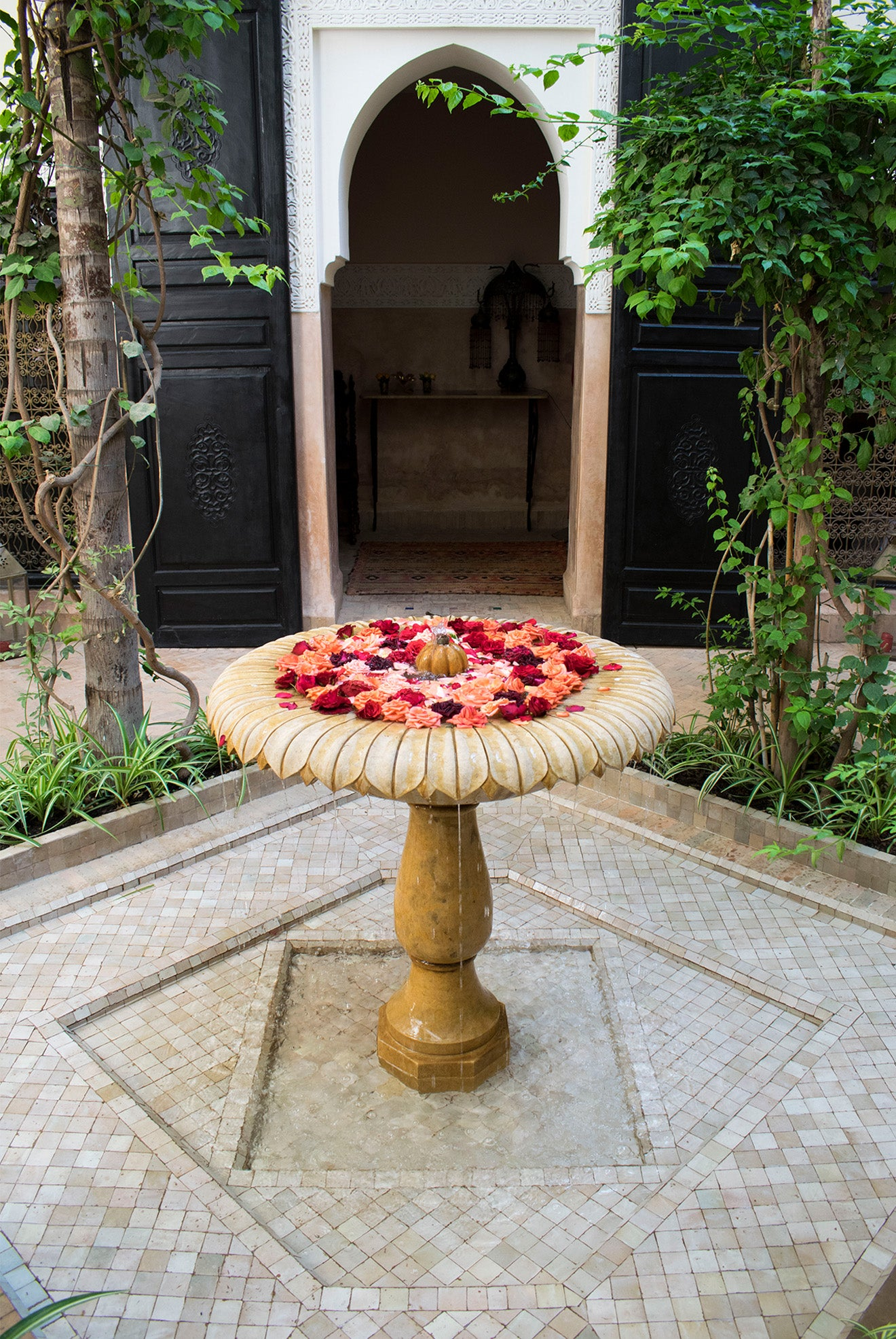 Moroccan fountain filled with red roses Dar Jaguar Marrakech