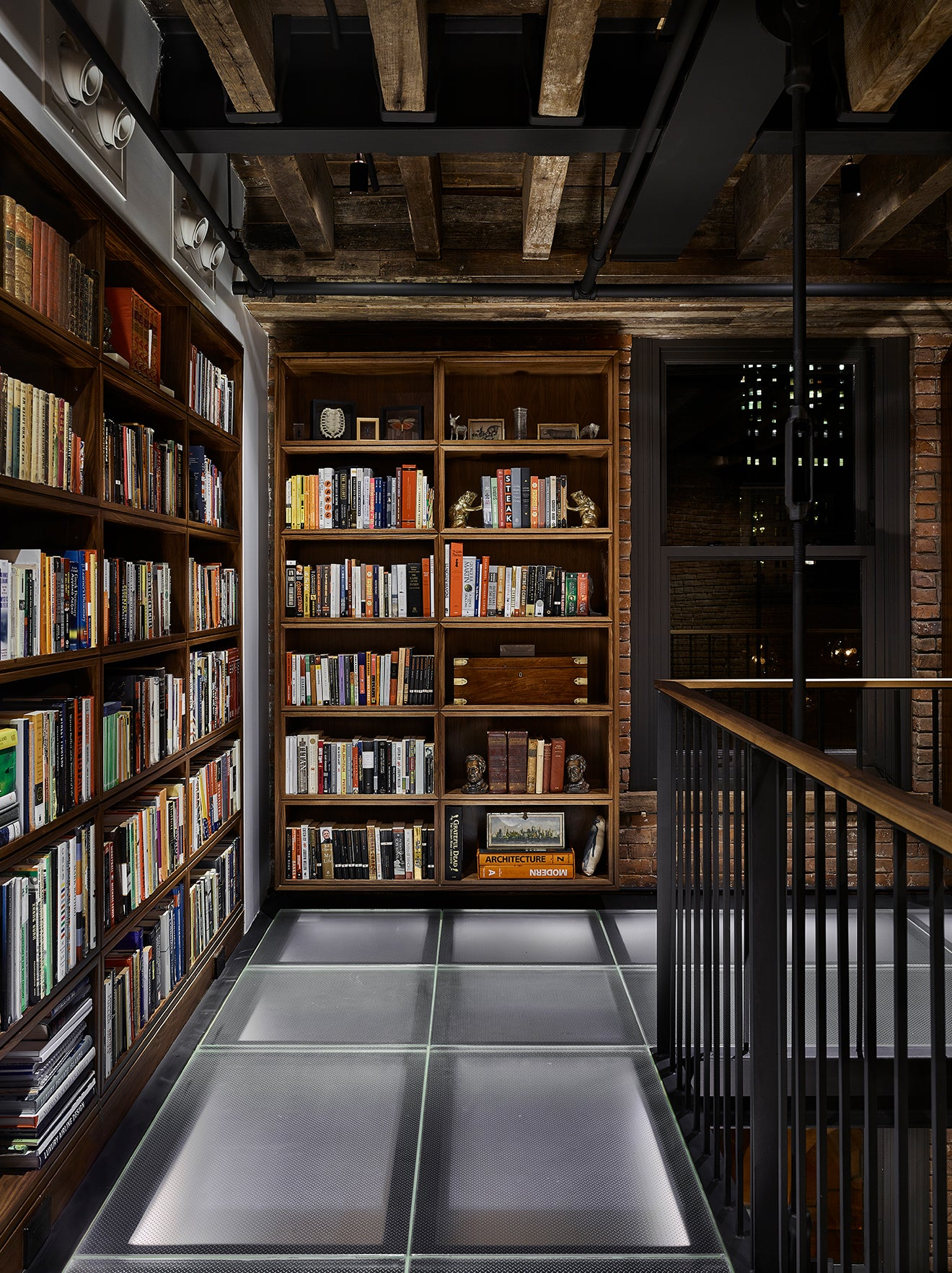 Galleried library industrial warehouse apartment New York
