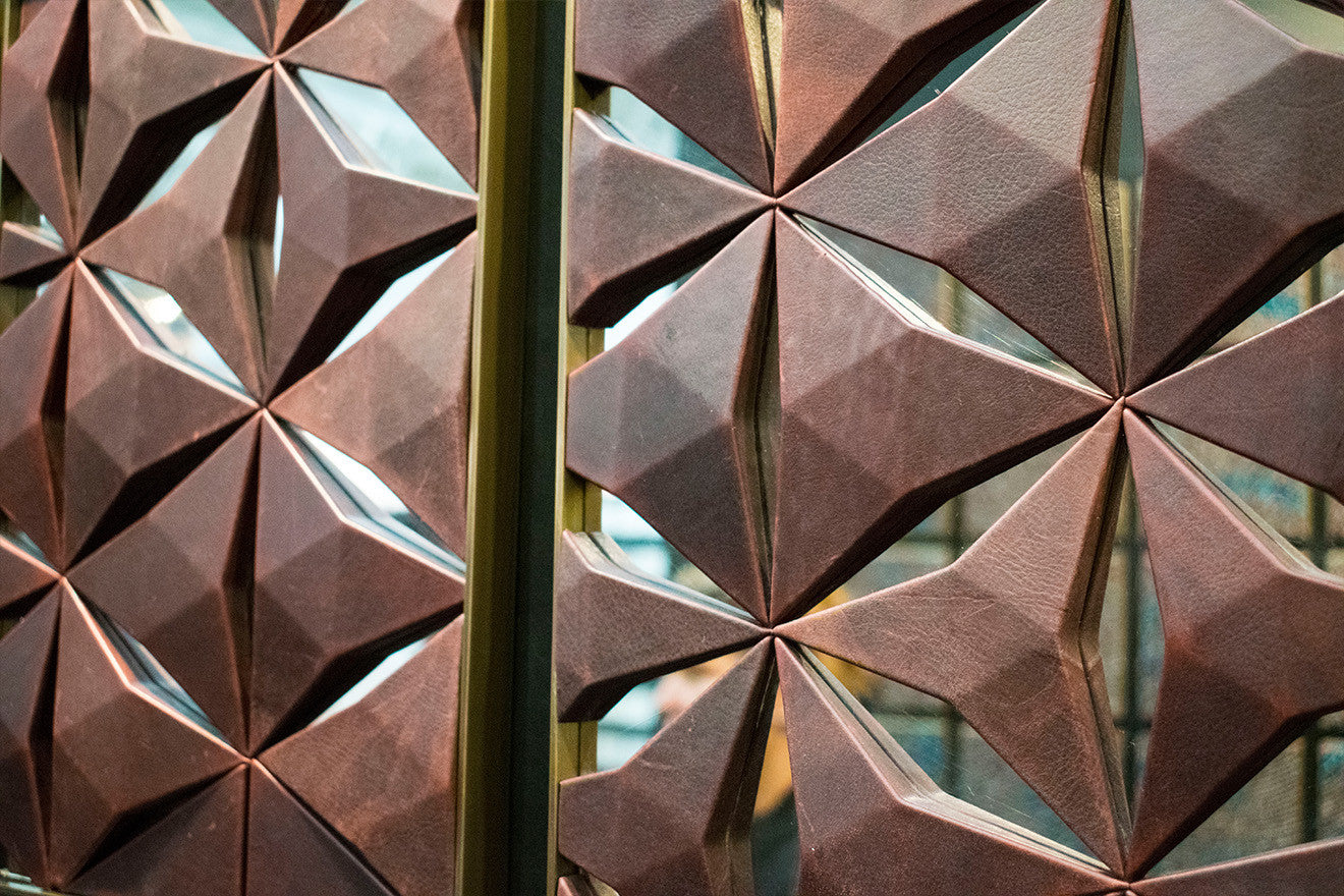 Geometric 3d shapes against a brass framed mirror Pintark Surface Design Show