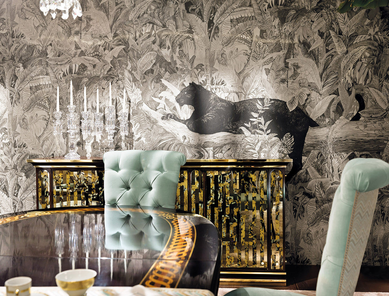Provasi black panther wallpaper with gold sideboard and mint coloured dining chair