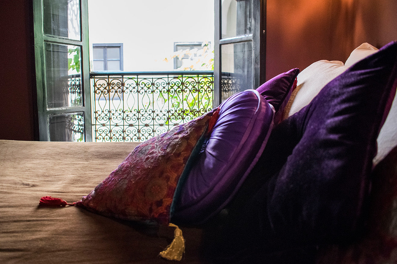 Moroccan silk and velvet pillows in purple and pink at Dar Jaguar Marrakech