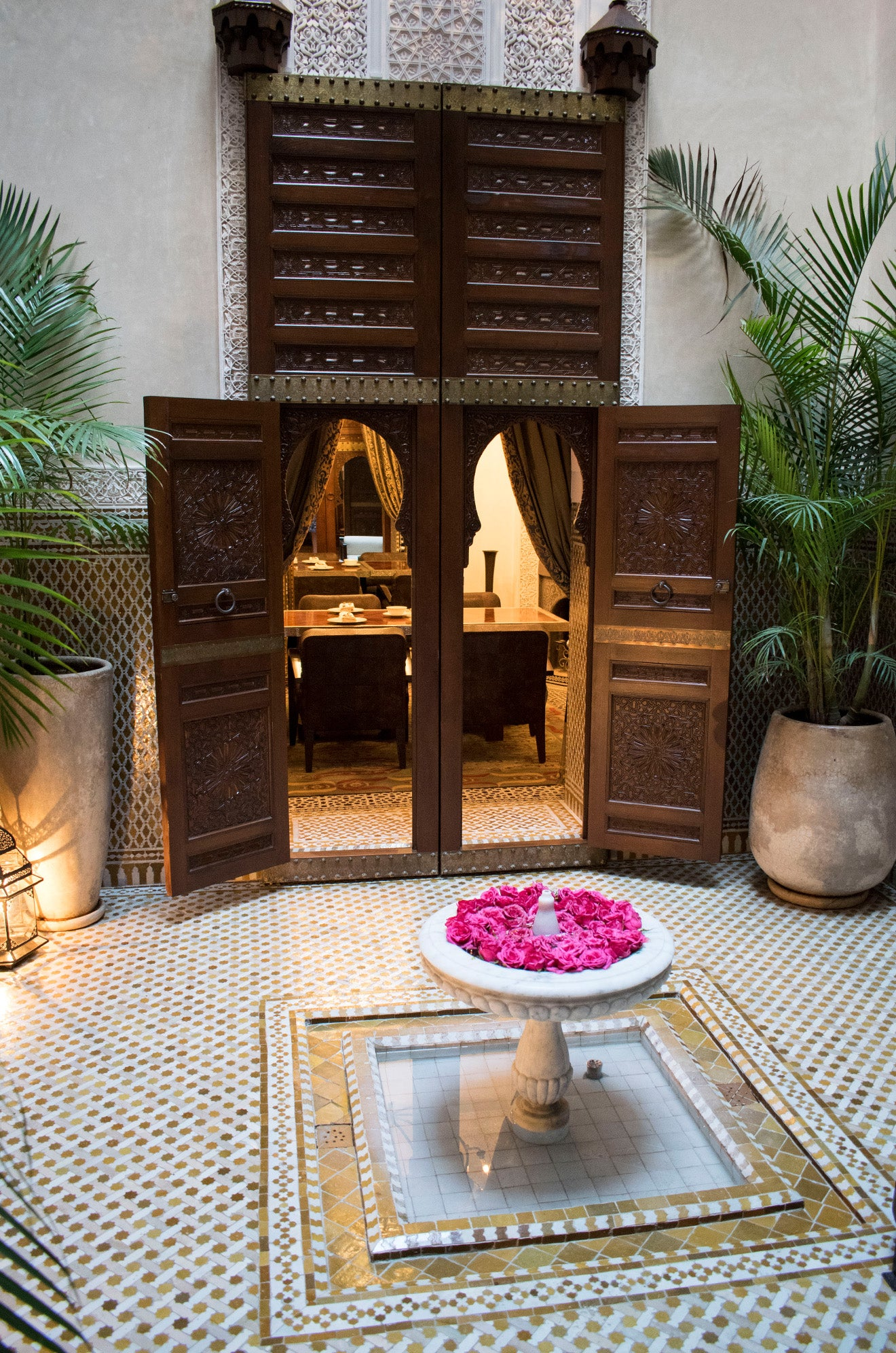 Moroccan central courtyard with rose filled fountain