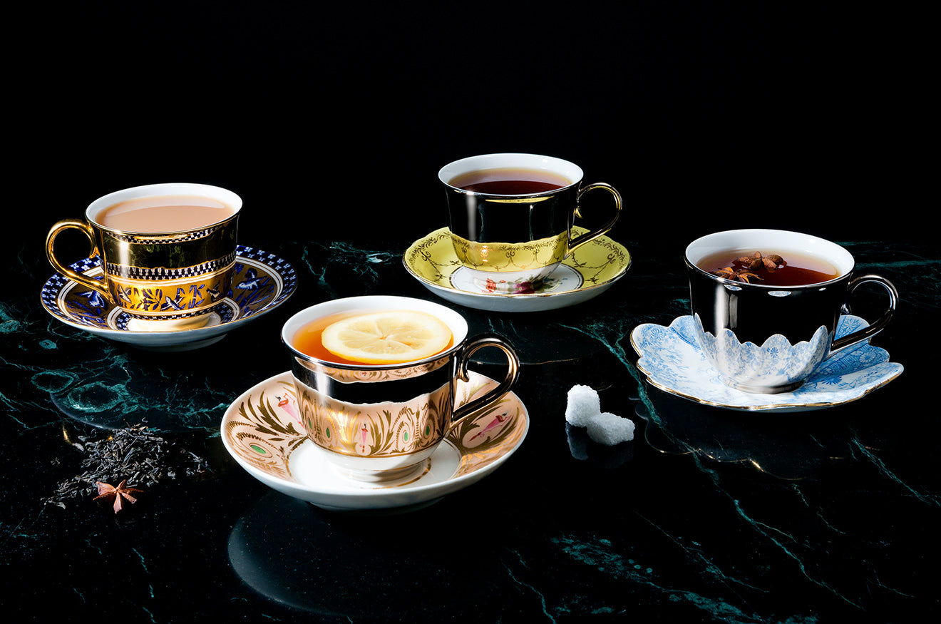 Reflective teacups against antique saucers designed by Richard Brendon