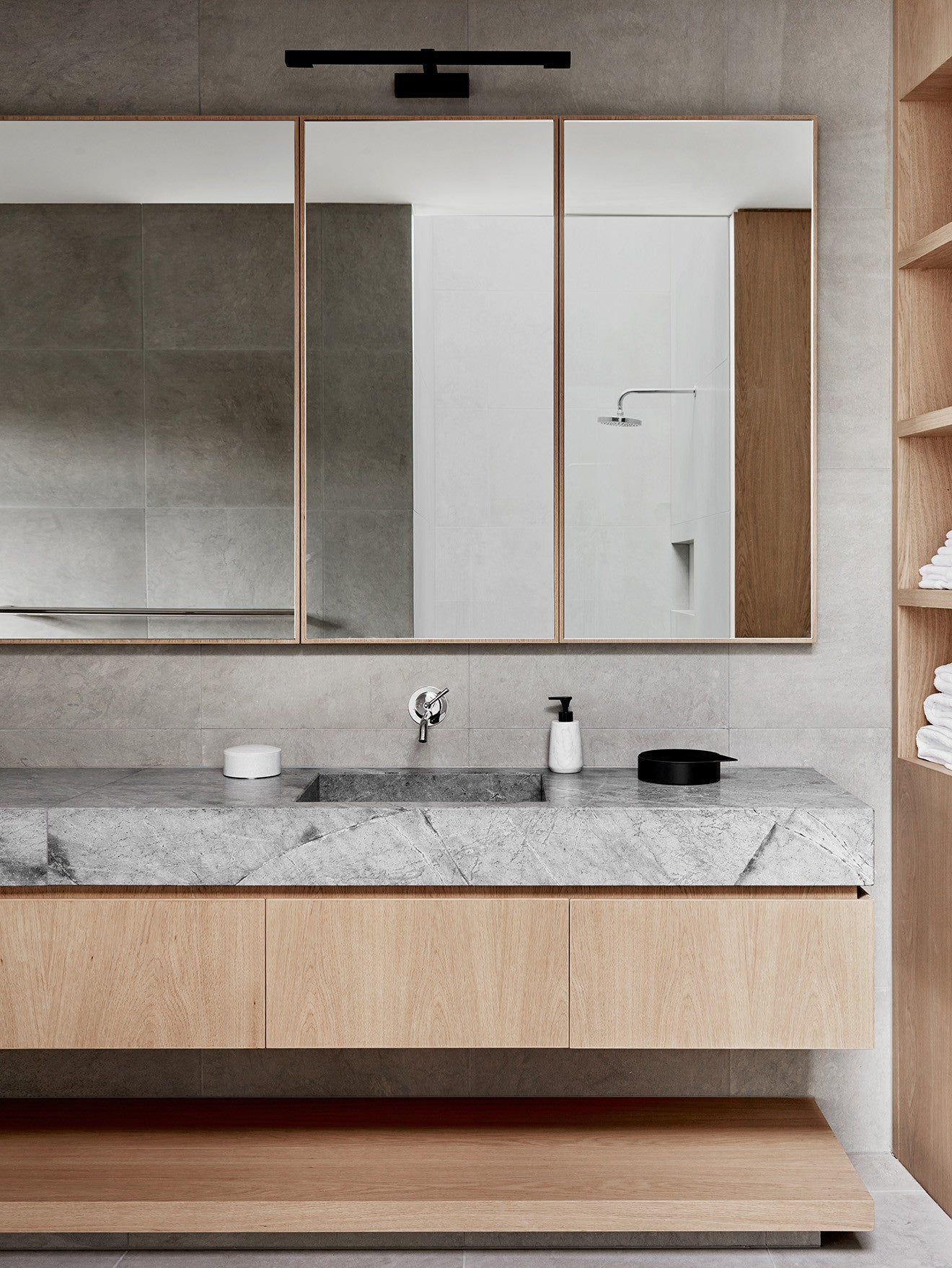 Light wood and grey stone bathroom by Robson Toorak