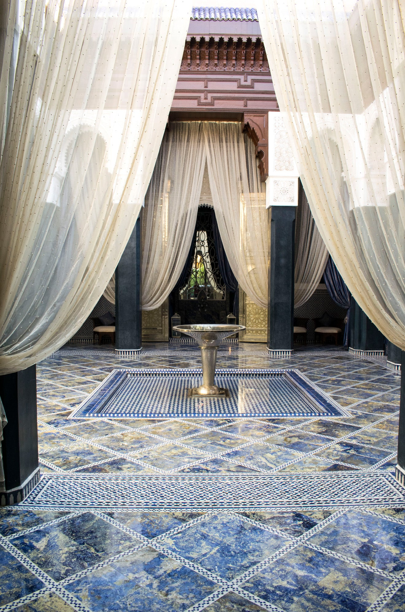Moroccan blue courtyard tiles with central stainless steel fountain