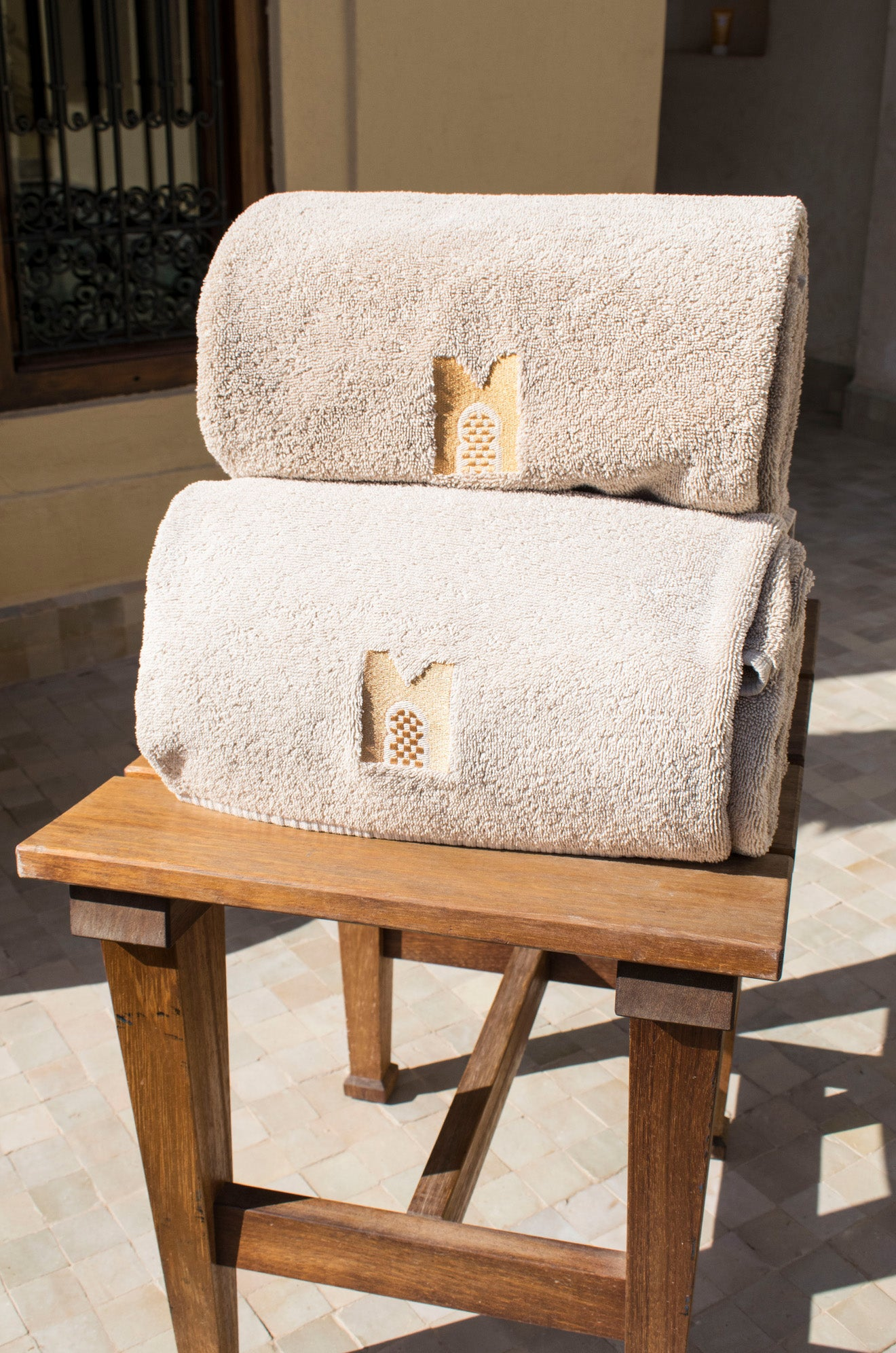 Royal Mansour logo towels