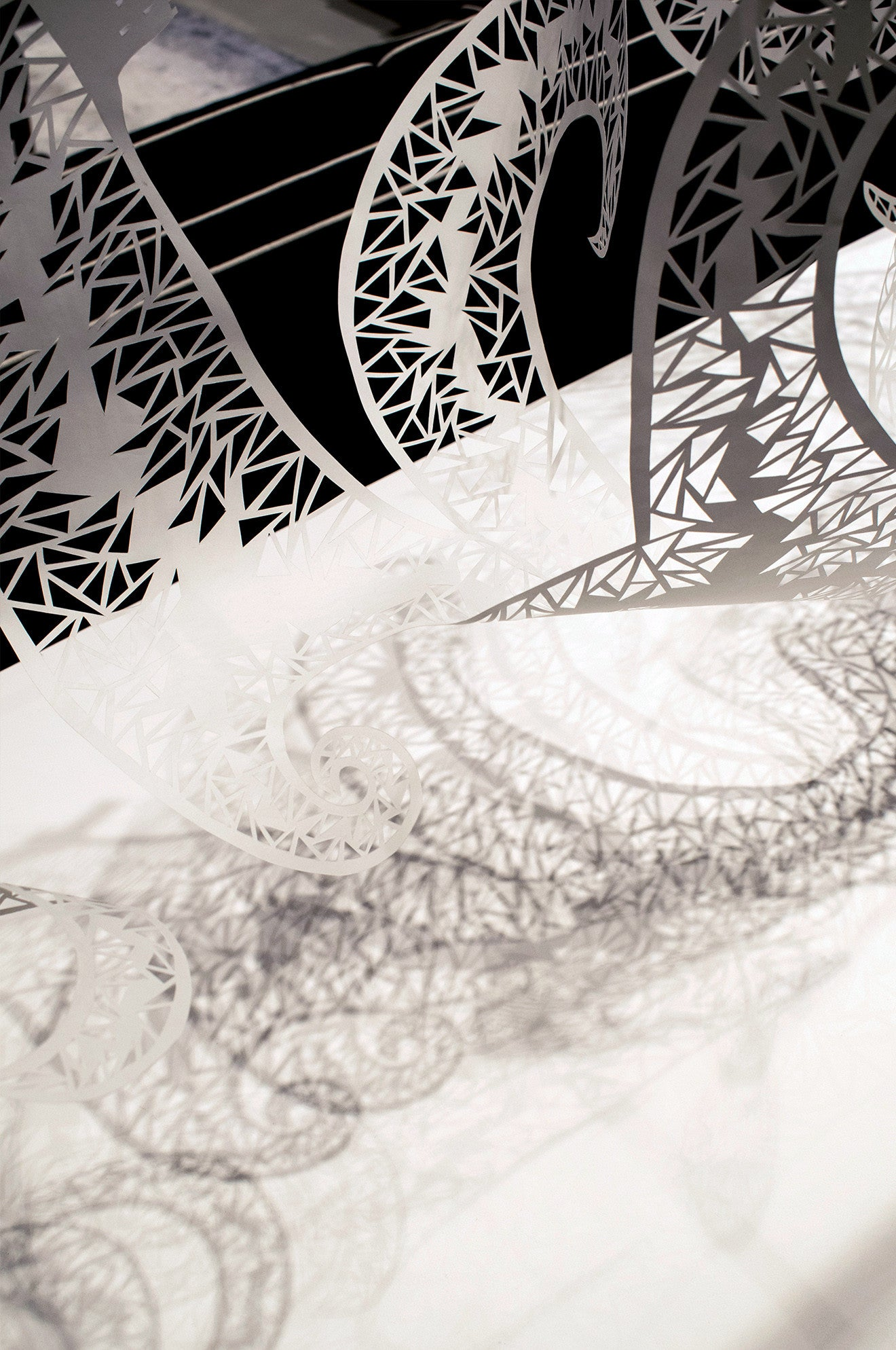 Beautiful hand cut artwork sculptures by Shannon Bartlett-Smith casting geometric shadows