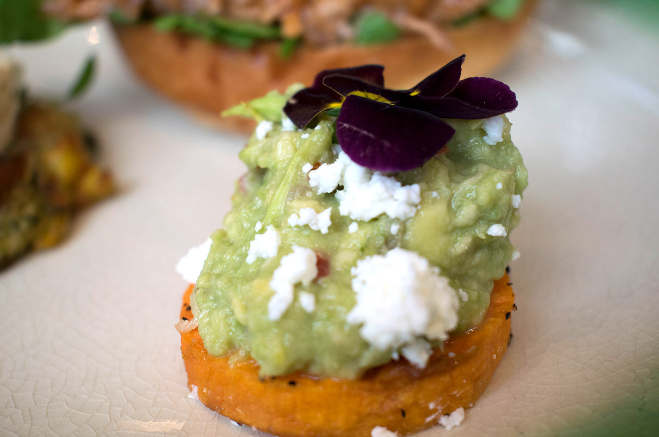 Smashed Avacado on Sweet Potato with Feta and Edible flowers at Social Pantry