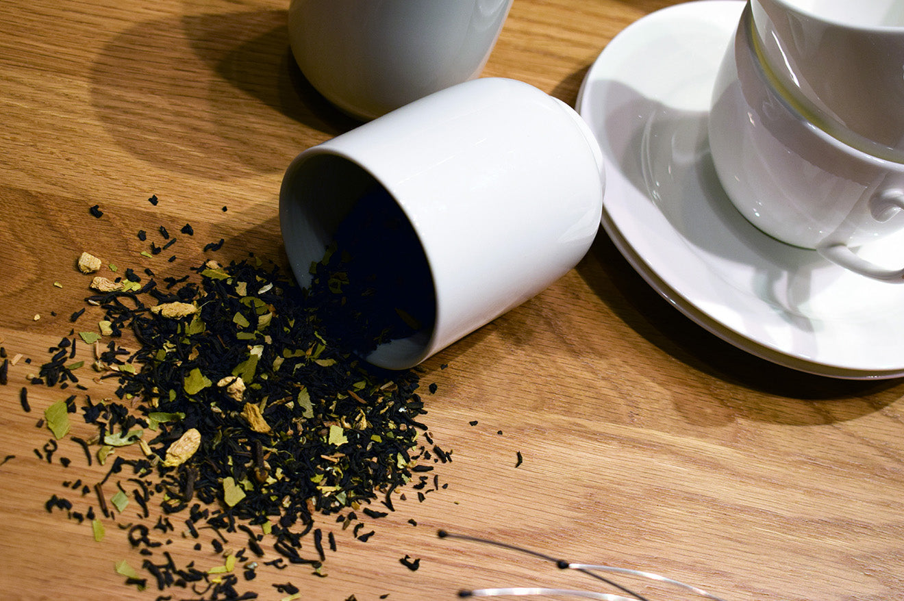 Spilt tea leaves in ceramic cup MUJI Window dressing